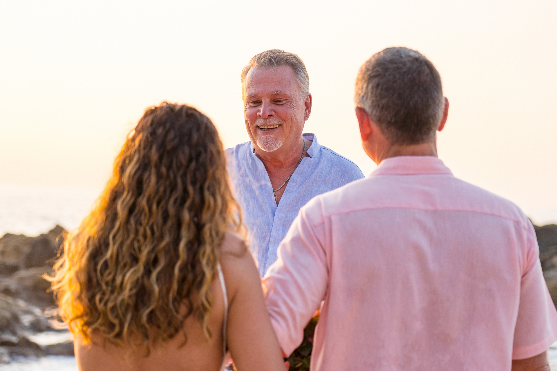 Playa Conchas Chinas, Mexico Beach Elopement Ceremony Photo | the groom is finally getting the chance to see his bride on their wedding day