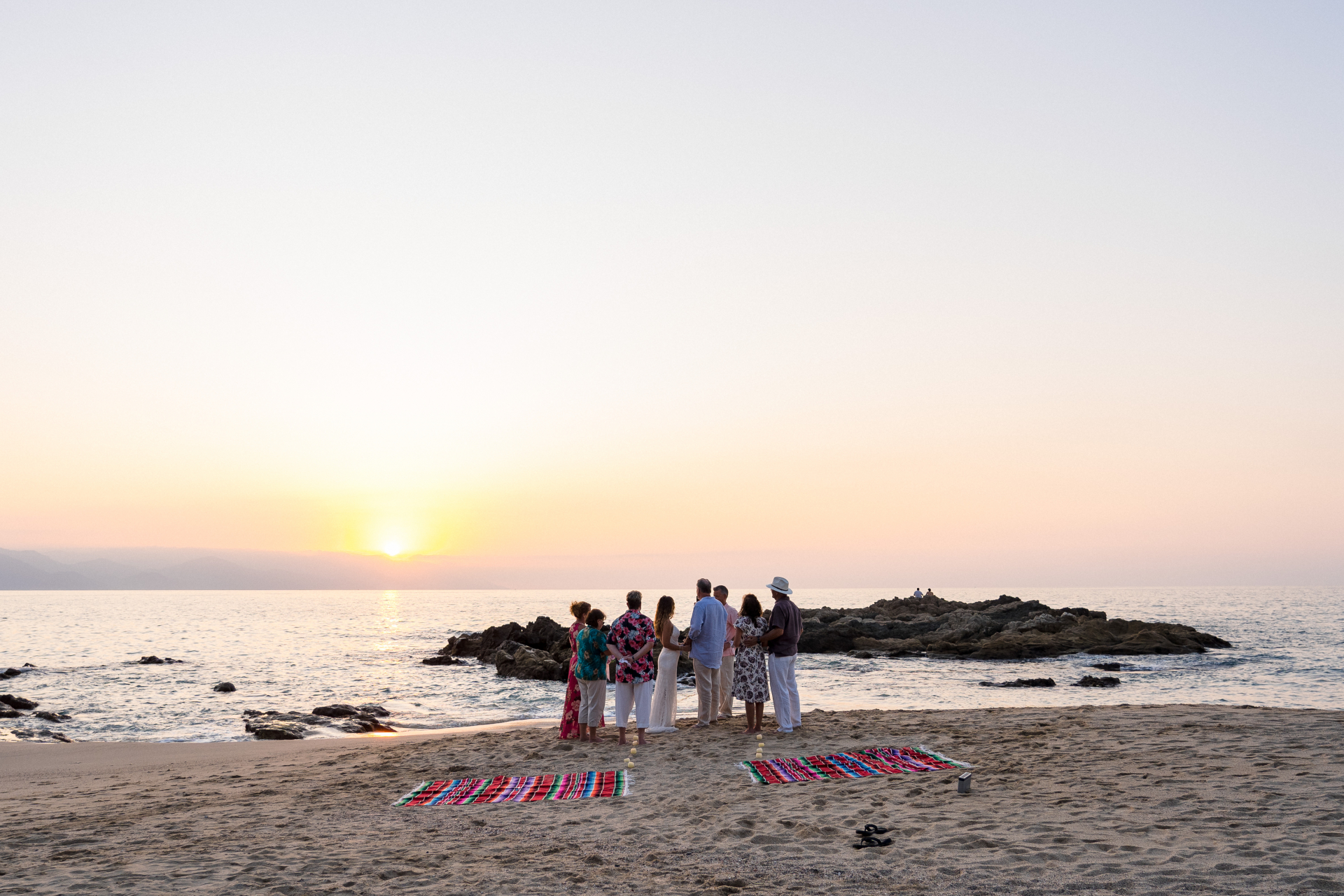 Playa Conchas Chinas, Puerto Vallarta Elopement Ceremony Image | The ceremony takes place by the water just as the sun begins to set