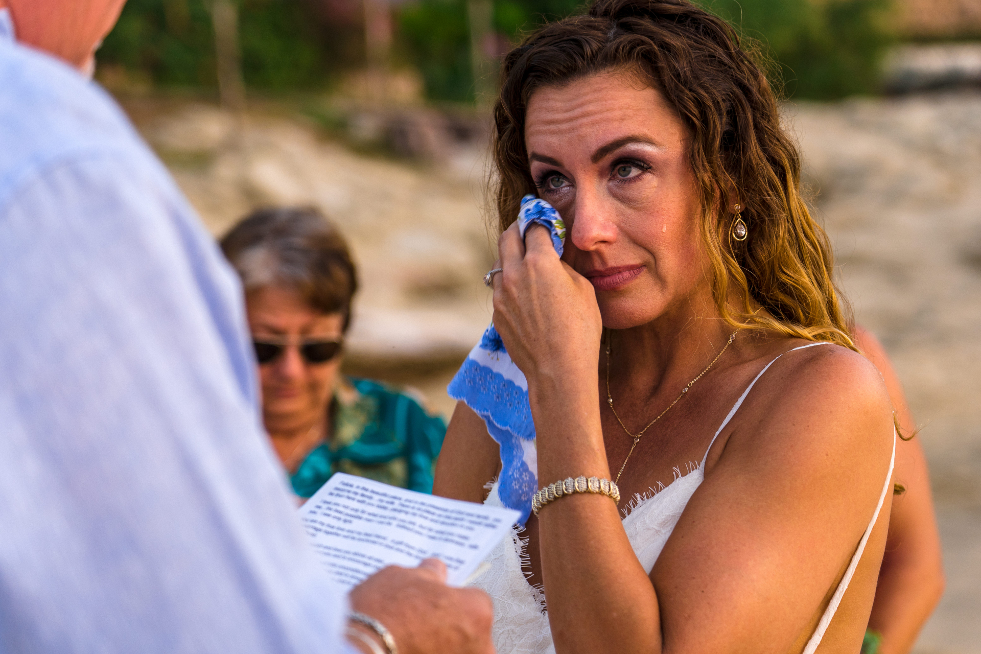 Puerto Vallarta Beach Ceremony Elopement Tear Picture | The bride can't help but tear up as she listens to the groom's vows