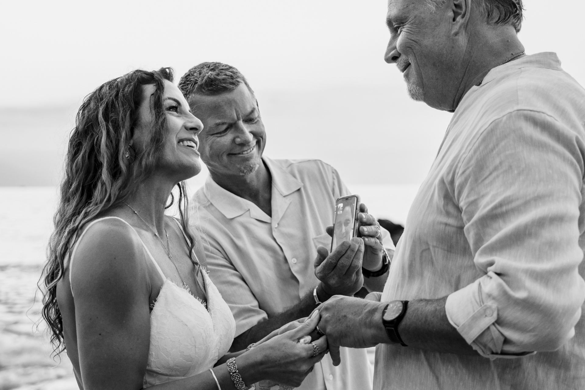 Puerto Vallarta Beach Elopement Vows Photography | the ceremony was led by their officiant through a long-distance video conference on a phone