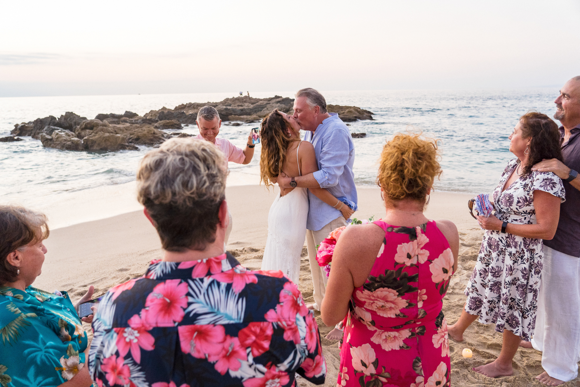 Mexico Beach Elopement Ceremony Photographer | The ceremony is now over, and the couple seals their marriage with a kiss