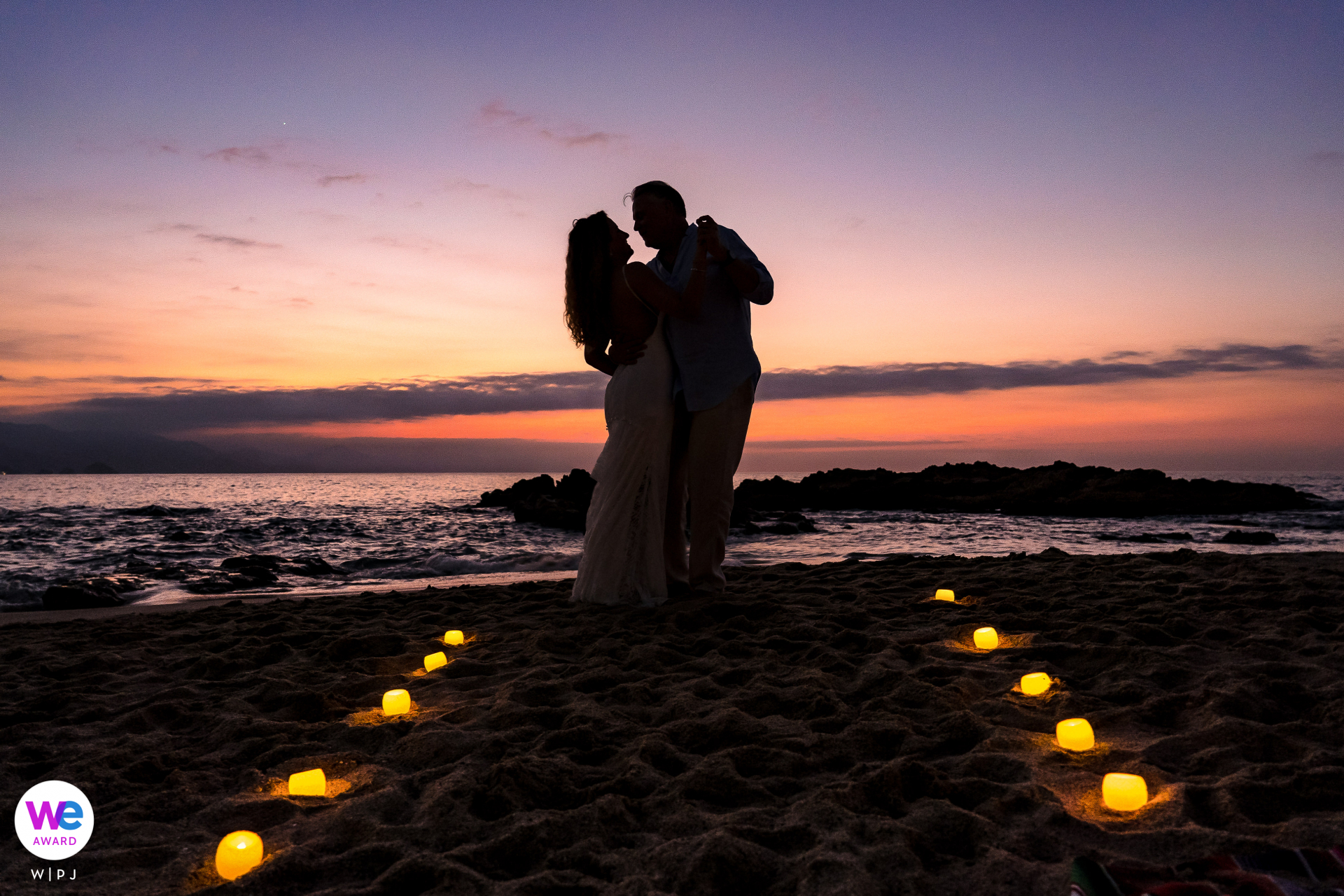 Playa Conchas Chinas, Puerto Vallarta, Mexico Elopement Couple Portrait | After the ceremony, the couple took a stroll on the beach together