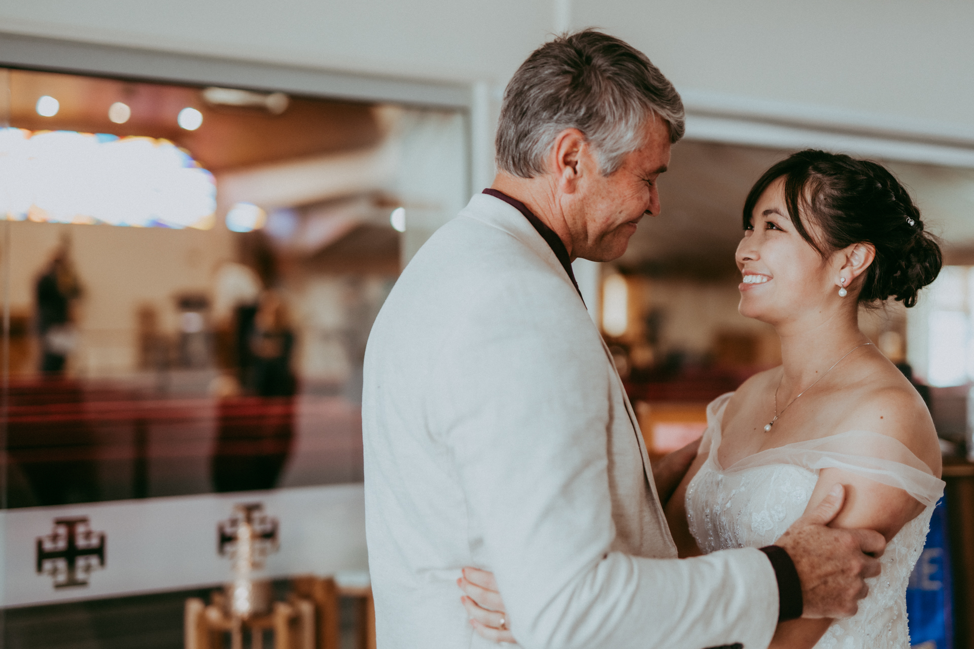 Christchurch, New Zealand Elopement Reception Photo | Father of the bride is immensely proud of his radiant daughter