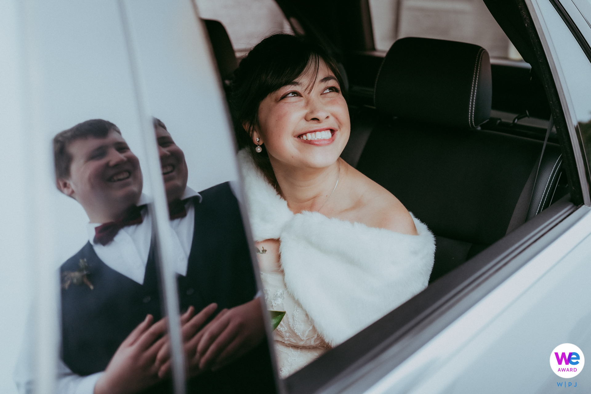 St. Christophers Church, Christchurch, New Zealand Elopement Photographer | The bride is still in the limo looking at the reflected groom
