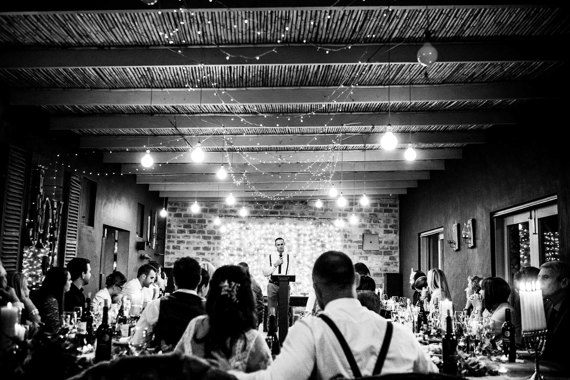Gelukkie Wedding Venue - Elopement Reception Party Photo | The newlyweds and their guests listen to the groom's brother