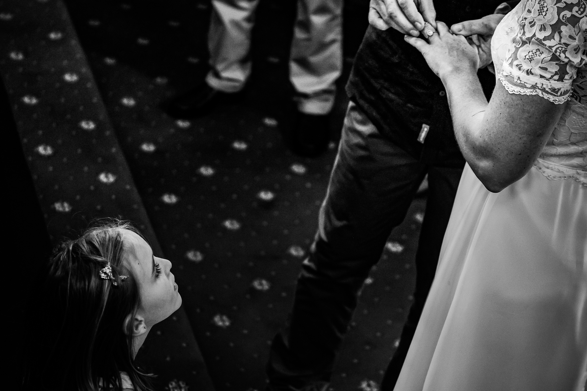 South Africa Elopement Photographer | A young girl looks on in wonder during the ring ceremony