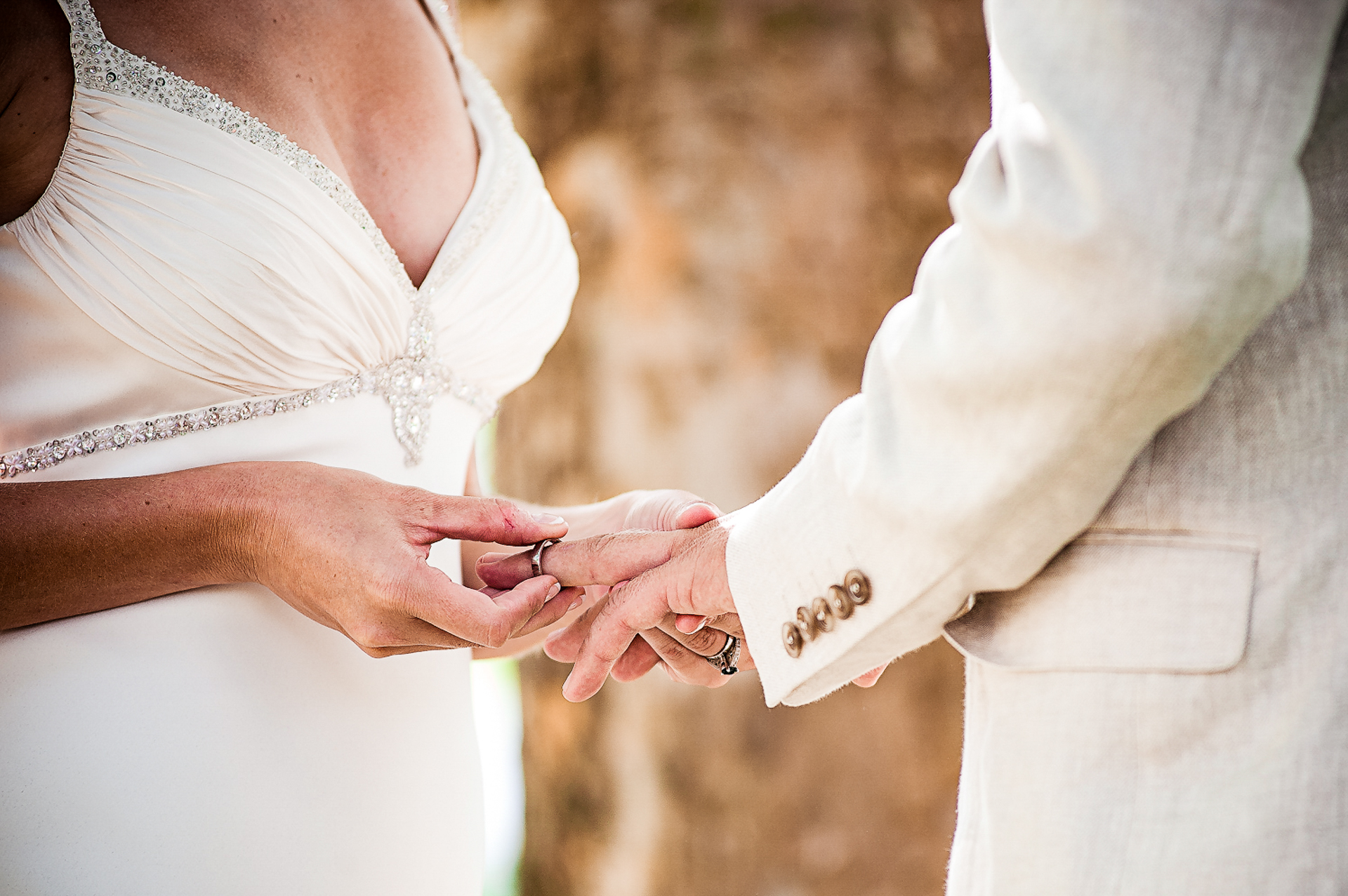 Western Cape, South Africa Elopement Ceremony Picture | The bride places the wedding ring on her groom