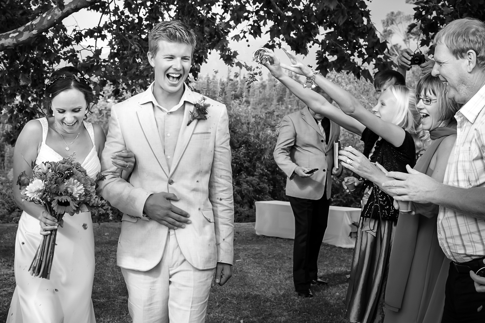 Western Cape, ZA Outdoor Elopement Ceremony Photo | The bride and groom are being showered by flower petals