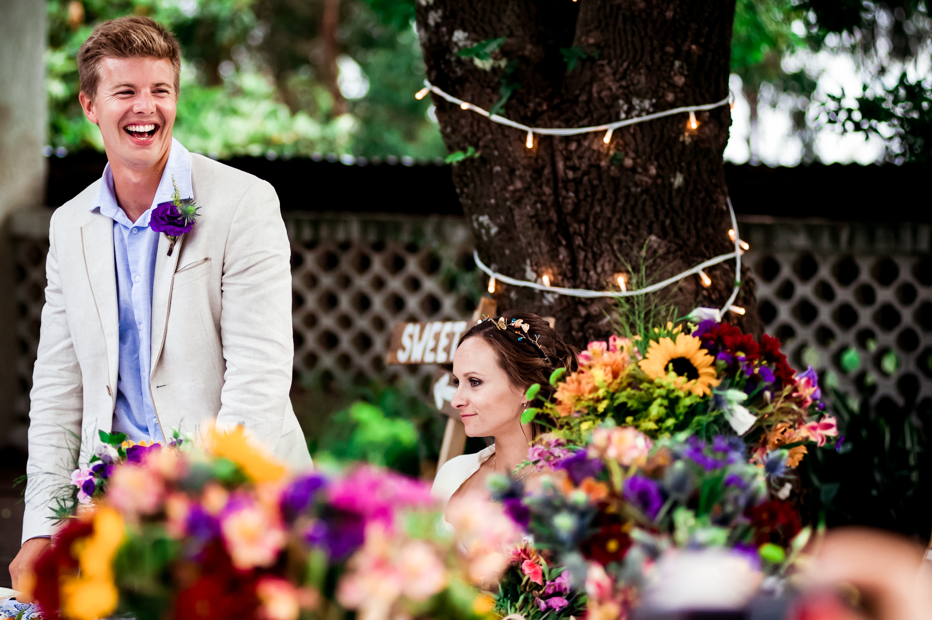 Western Cape, SA Elopement Venue Image | The groom laughs at a comical moment
