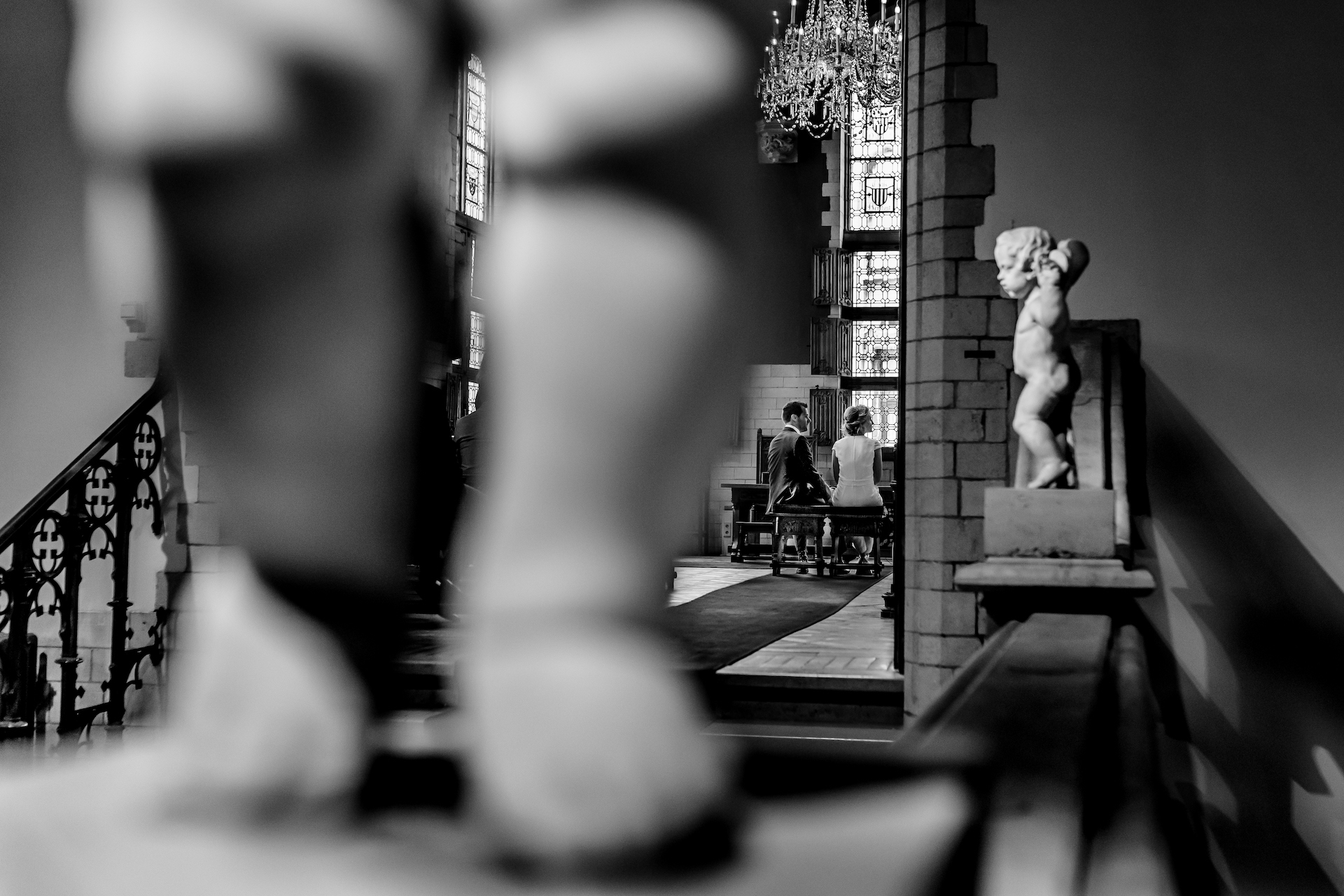 Belgium Civil Elopement Ceremony Photos | a view from behind one of the statues that decorates the hallway outside the room where the ceremony will take place