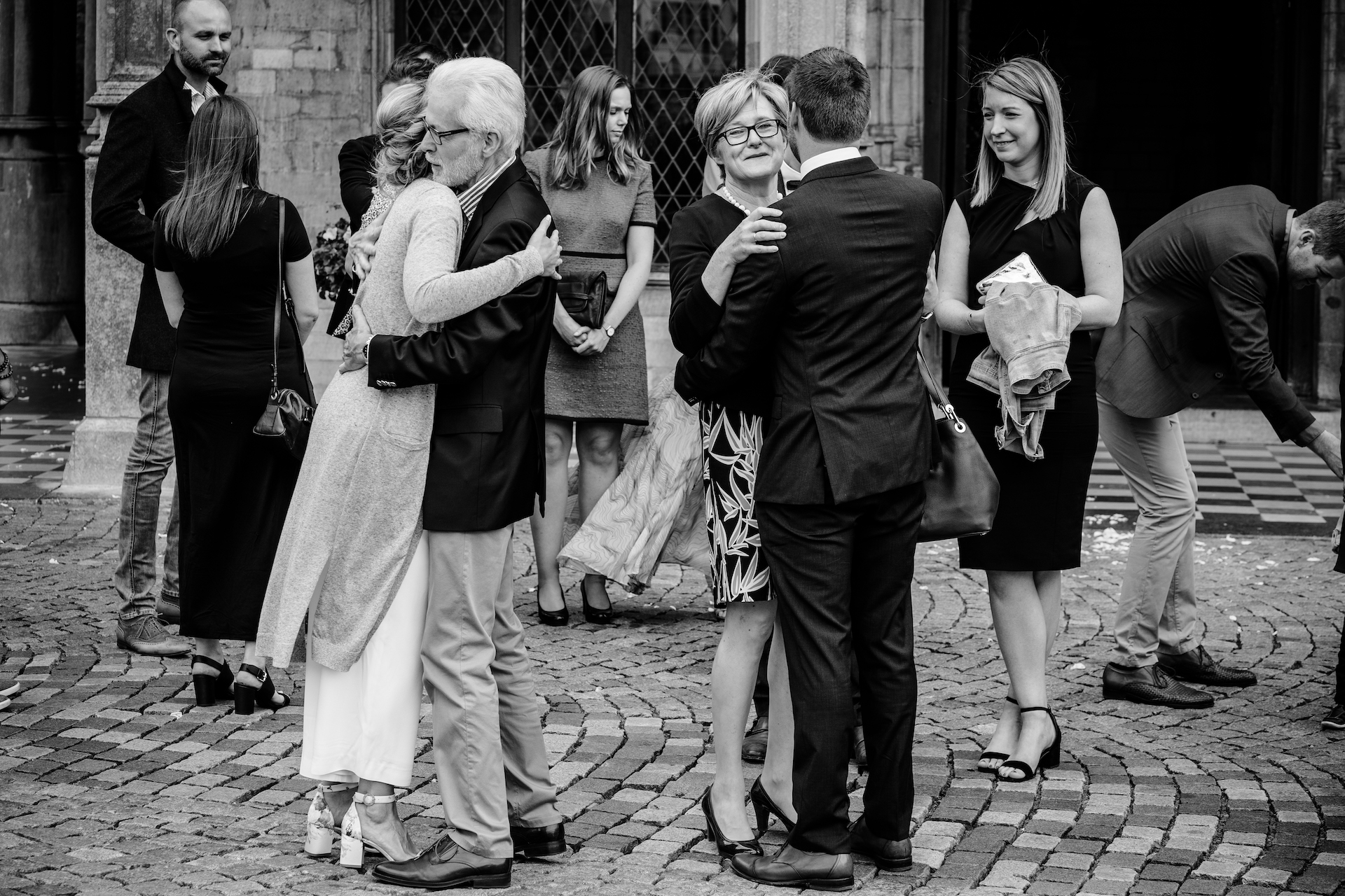 Town Hall of Mechelen Belgium Elopement Photo | everyone is back outside after the ceremony