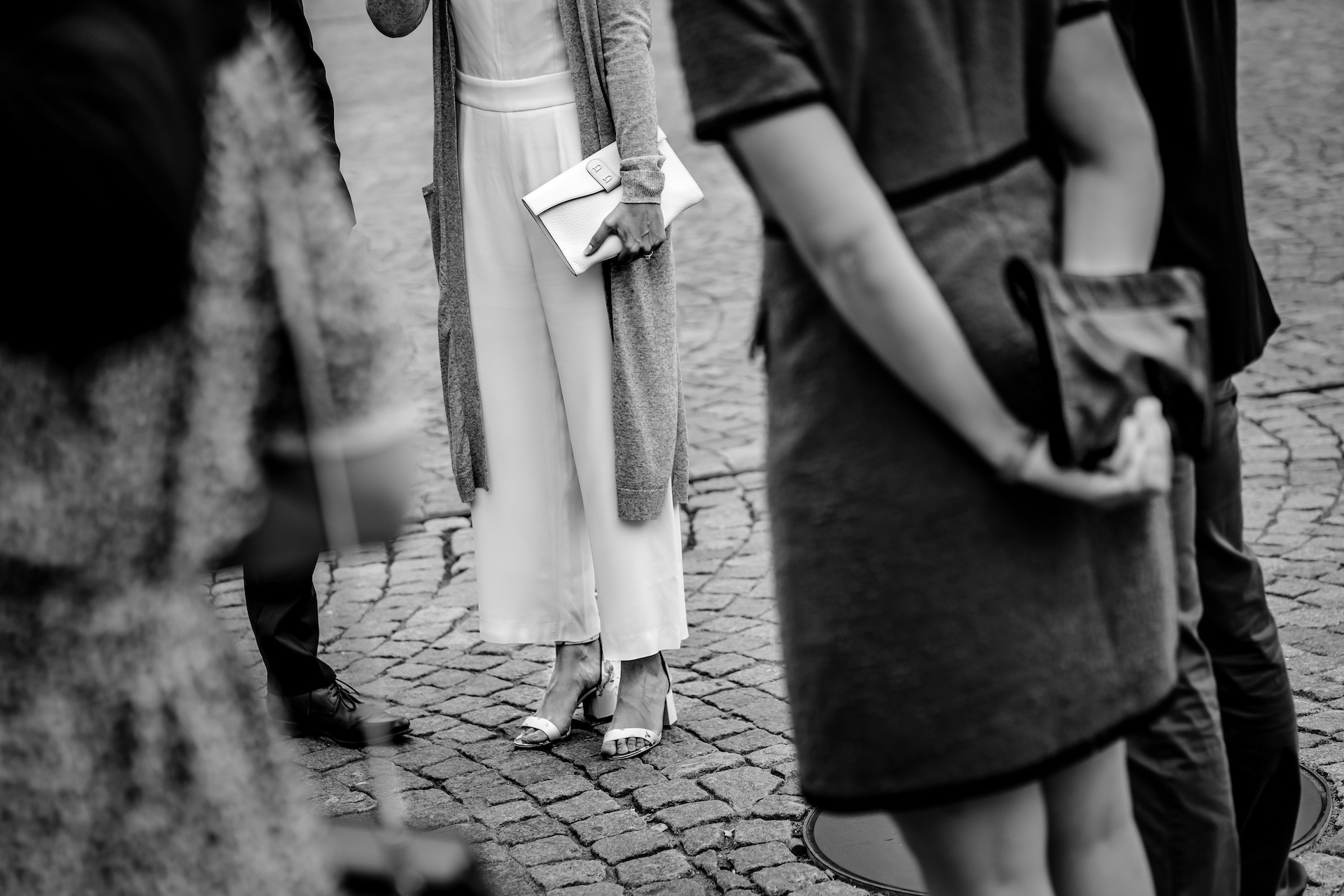 Belgium Elopement Image Detail | the bride along with family and friends gather together at the town square