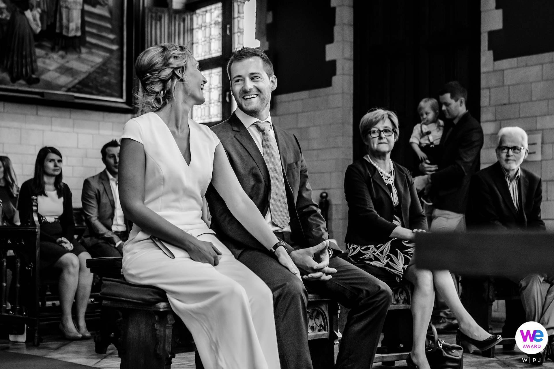 Mechelen, Belgium Elopement Ceremony Photographer | The couple sits together on a bench as the ceremony begins