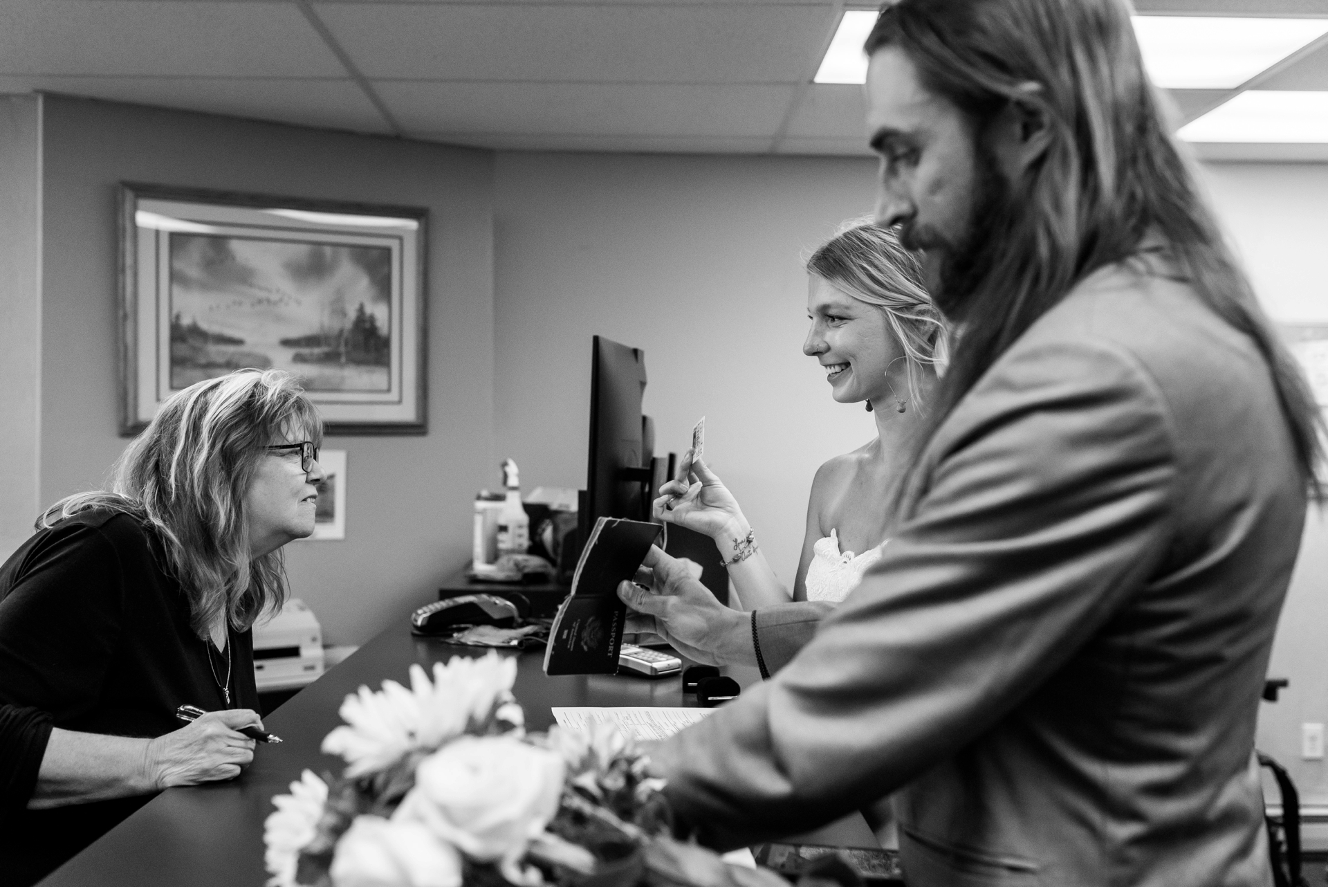 South Lake Tahoe Civil Ceremony Elopement Image | The bride and groom show their ID's to the county clerk before their civil ceremony