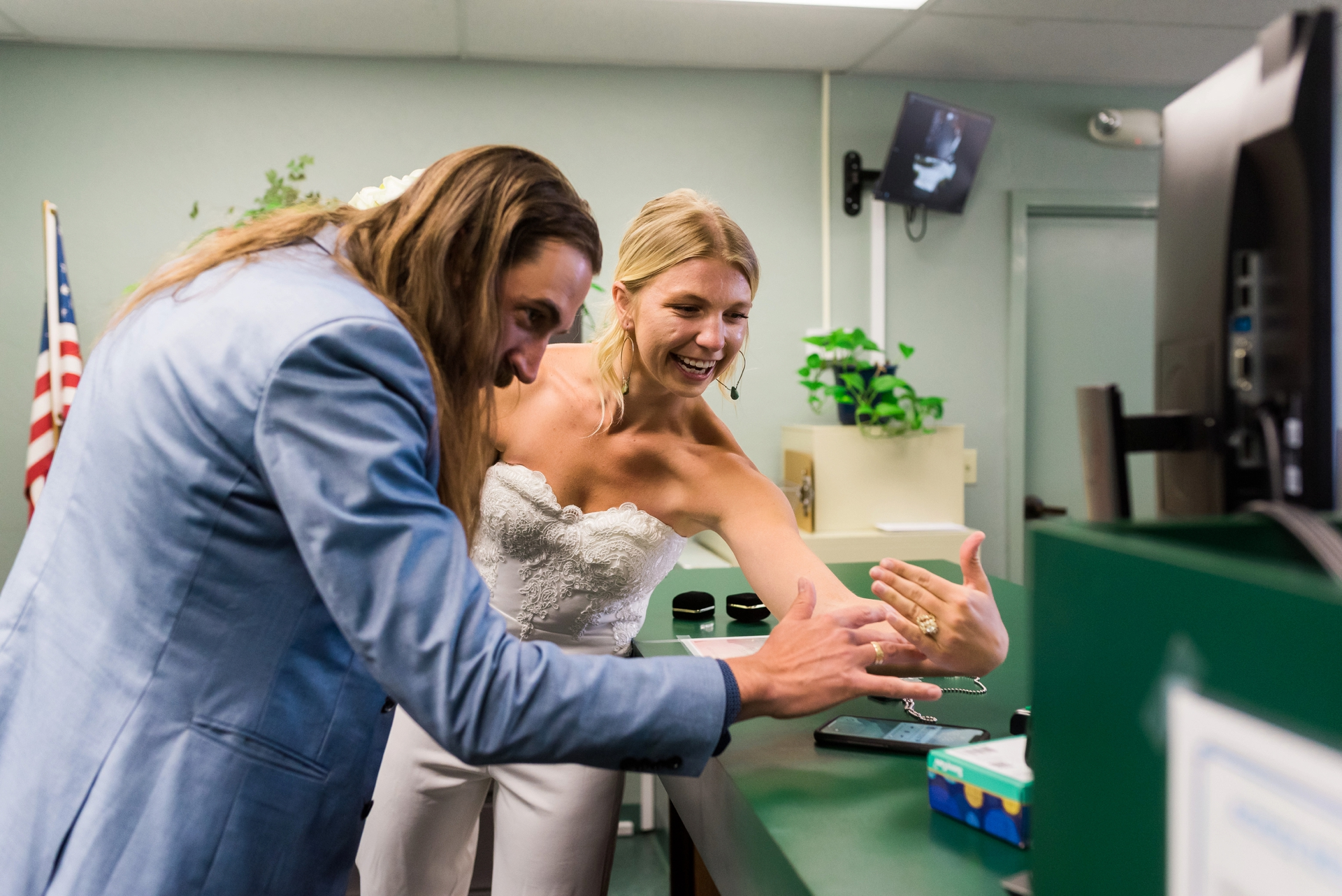 County Clerk Office Zoom Ceremony Photo from CA | The newlyweds show off their wedding rings