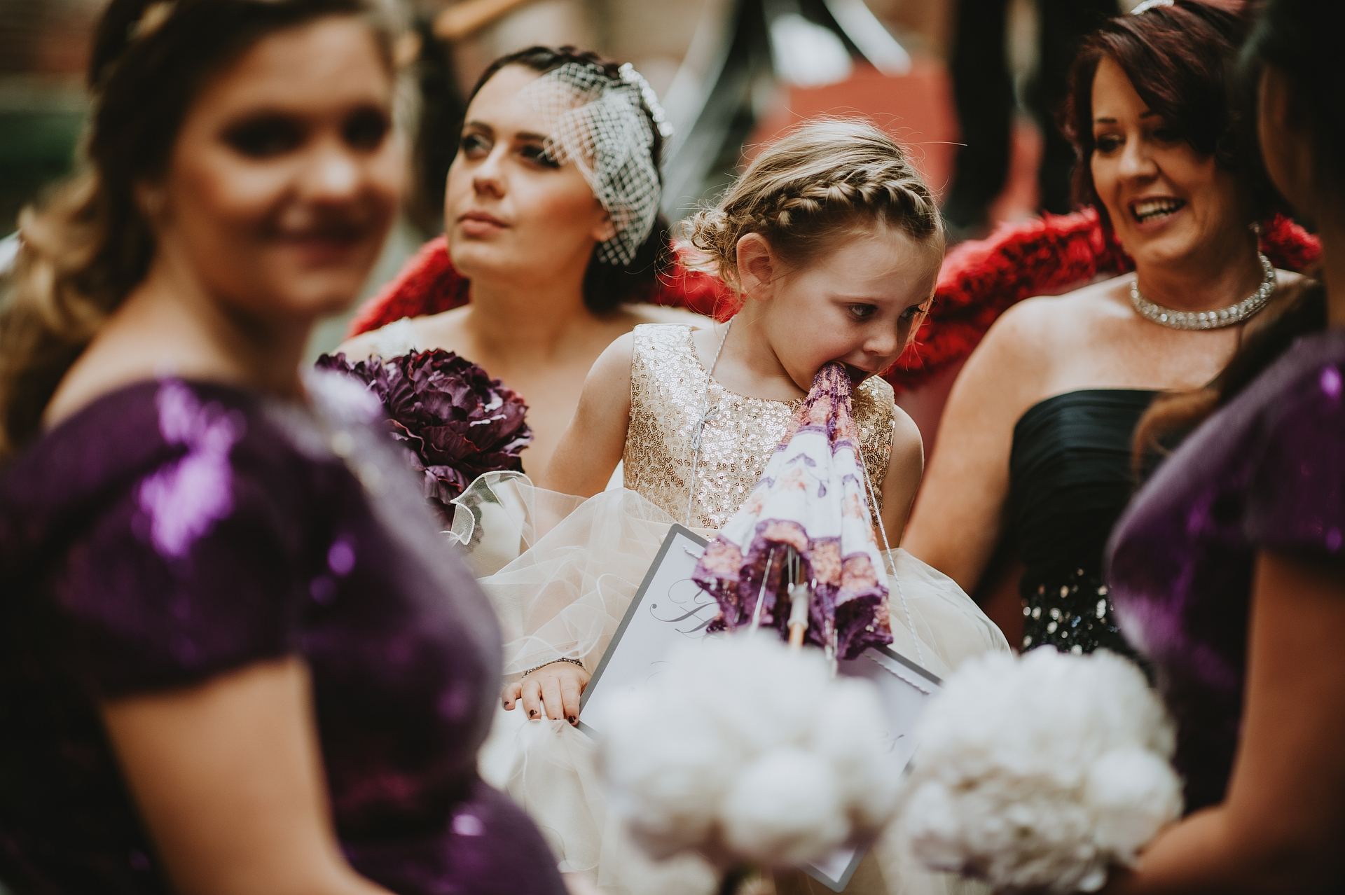 Elopements in Torcello - Italian Wedding Images | While moving by taxi, the little girl begins to eat the umbrella she holds in her hand