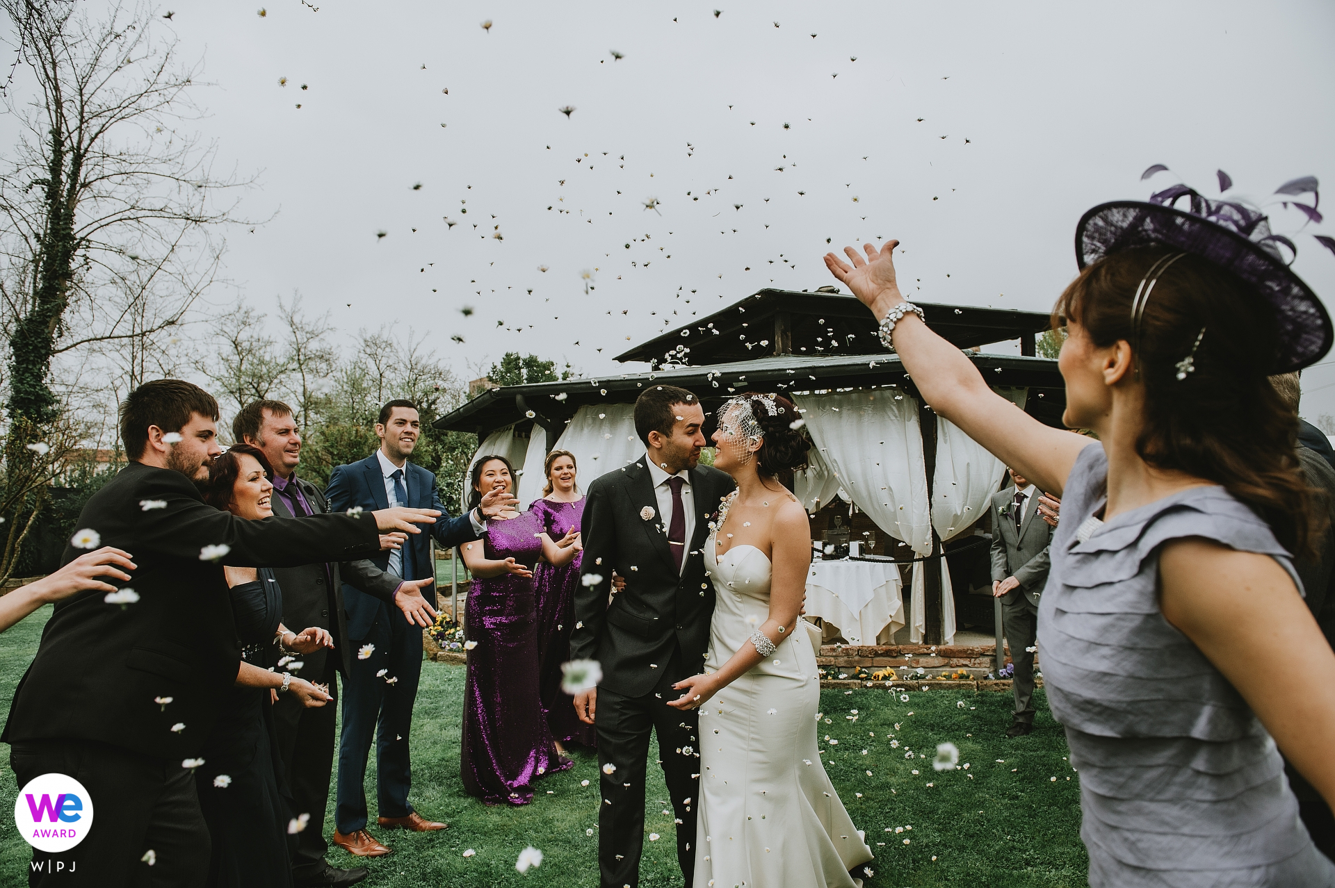 Intimate Torcello Island Elopement Ceremony Picture - the moment of the rice launch for the couple