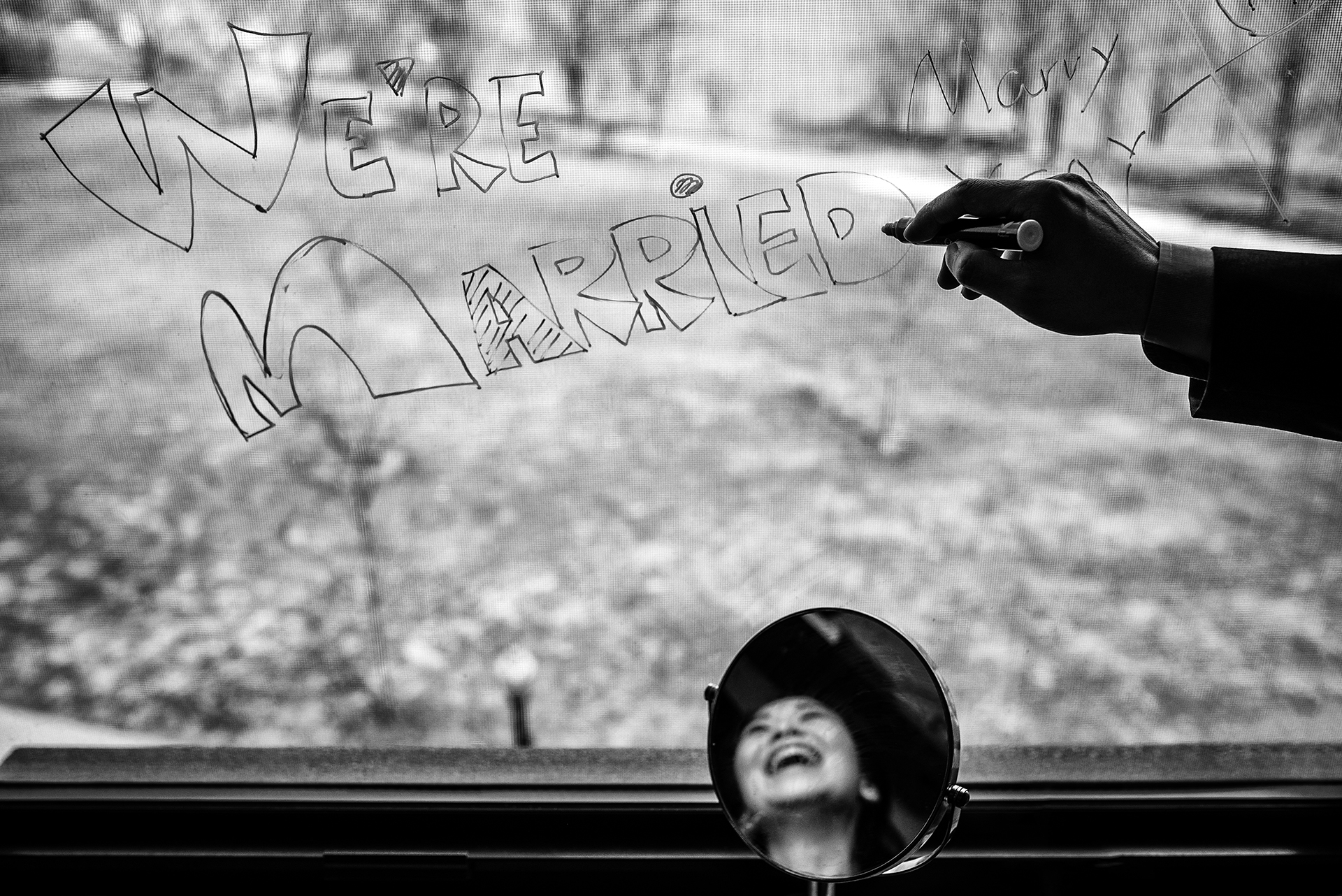"""Boston City Hall Wedding Photography   the groom sketched """"We're Married"""" on their apartment window"""