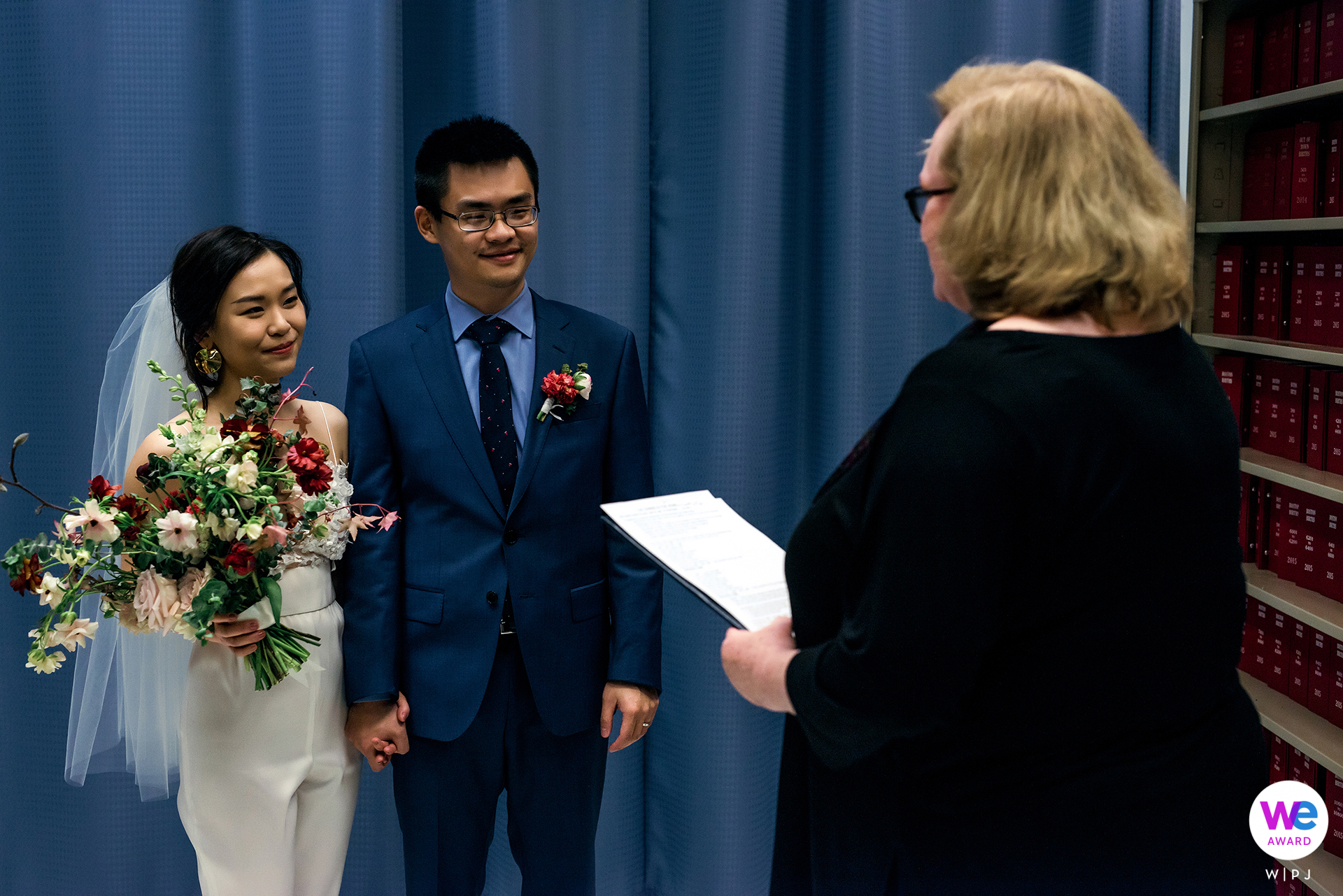 Boston's Best City Hall Wedding Photographer   The couple stand with their officiant during the civil elopement