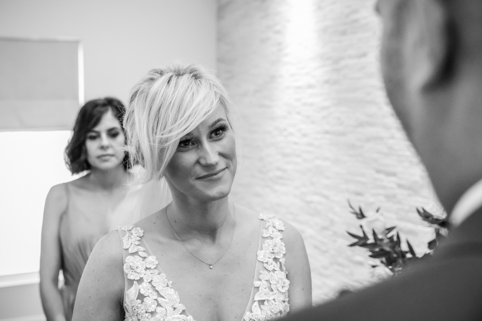 The Toronto Bride - Indoor Elopement Ceremony Picture | The way the bride looks at the groom says it all