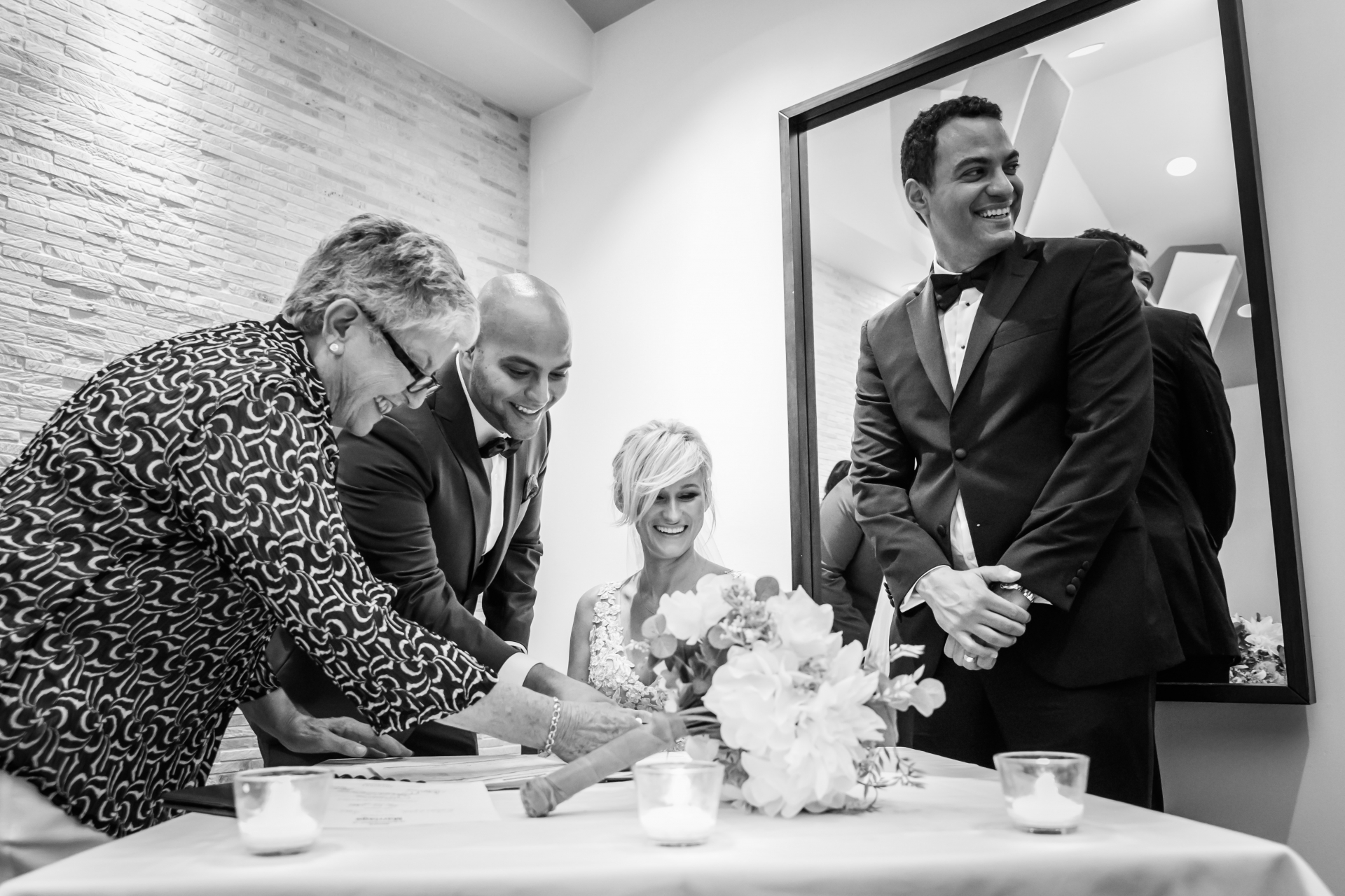 Canada Elopement Marriage Photo from the Toronto Ceremony | A light moment shared while signing the marriage documents