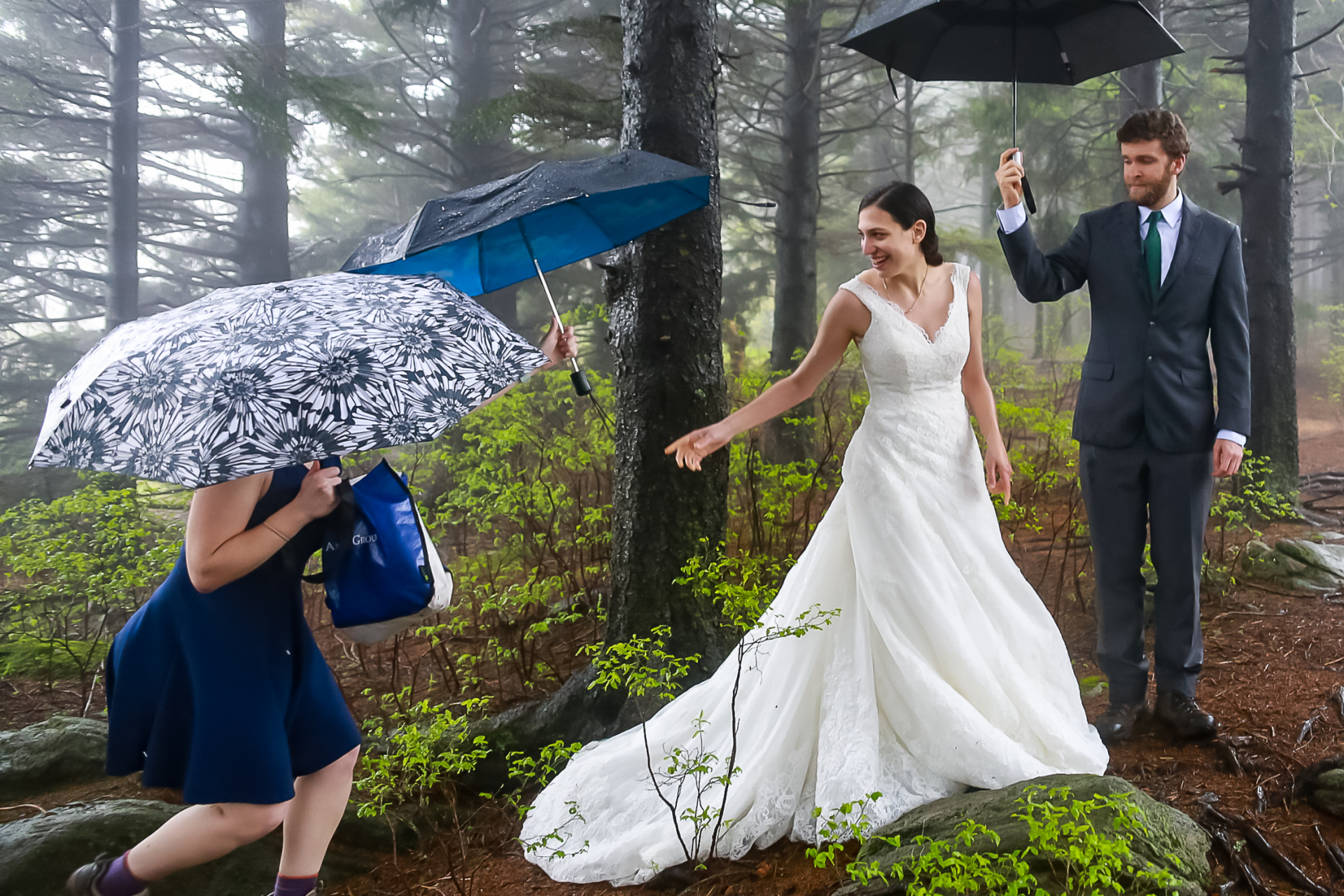 Black Balsam Knob, North Carolina Elopement Ceremony Picture | The maid of honor delivers an umbrella to the bride
