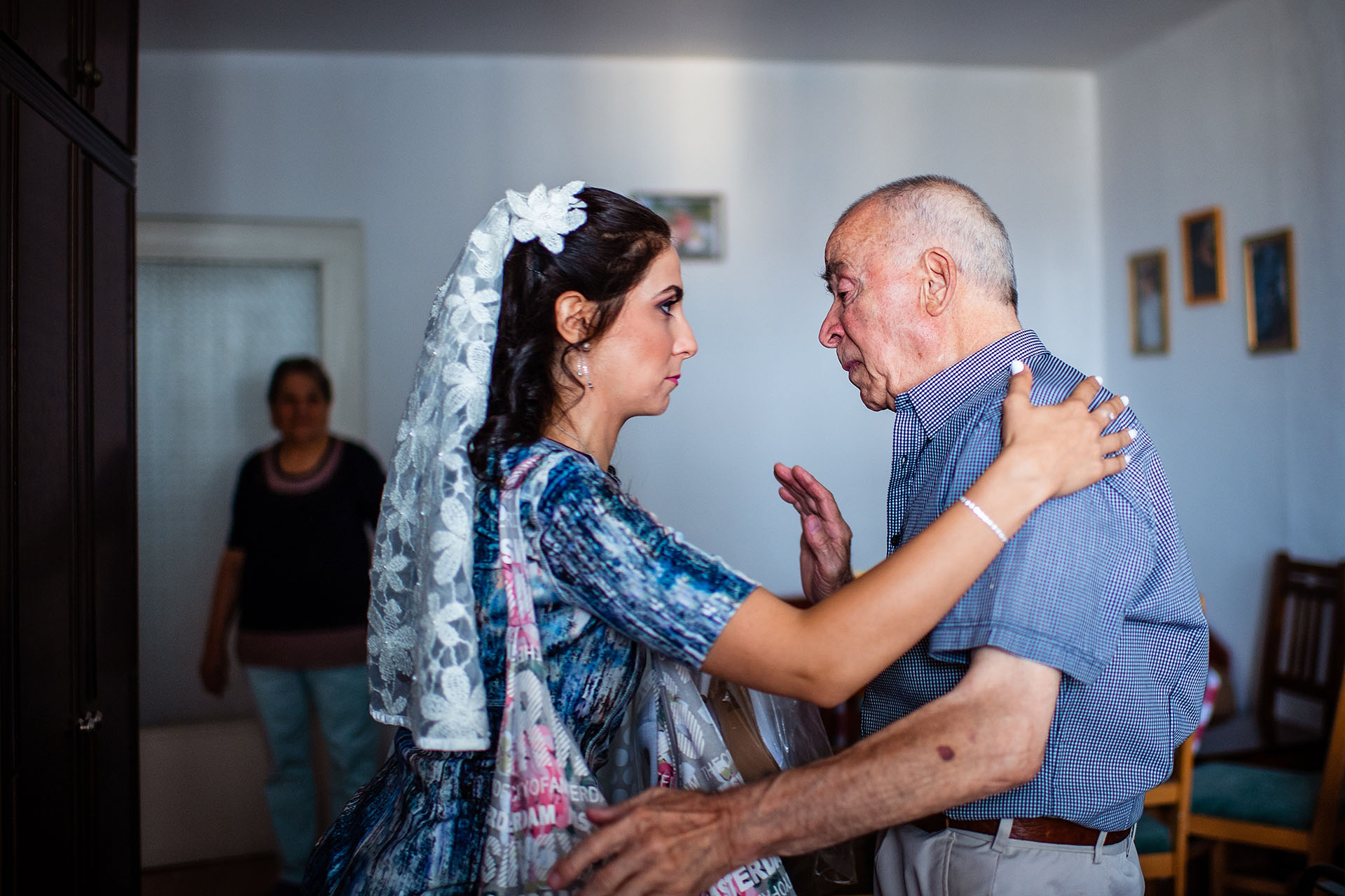 Club Horizont, Varna, Bulgaria Elopement Bride Photo | The bride and her grandfather share an emotional moment before the ceremony