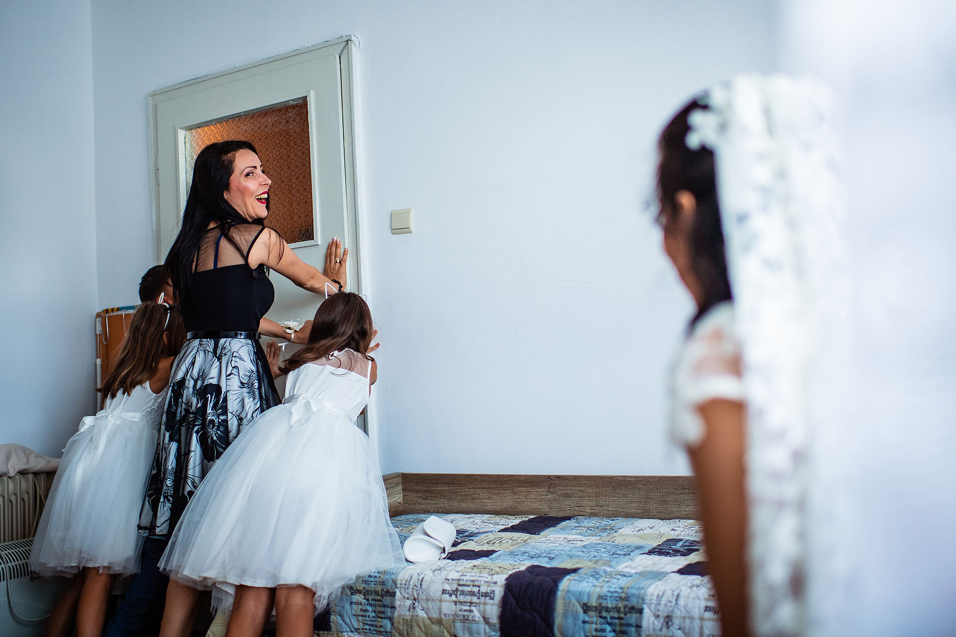Varna, Bulgaria Elopement Bride Pre-Ceremony Image | The groom and his family have finally arrived, and they stand waiting in front of the door