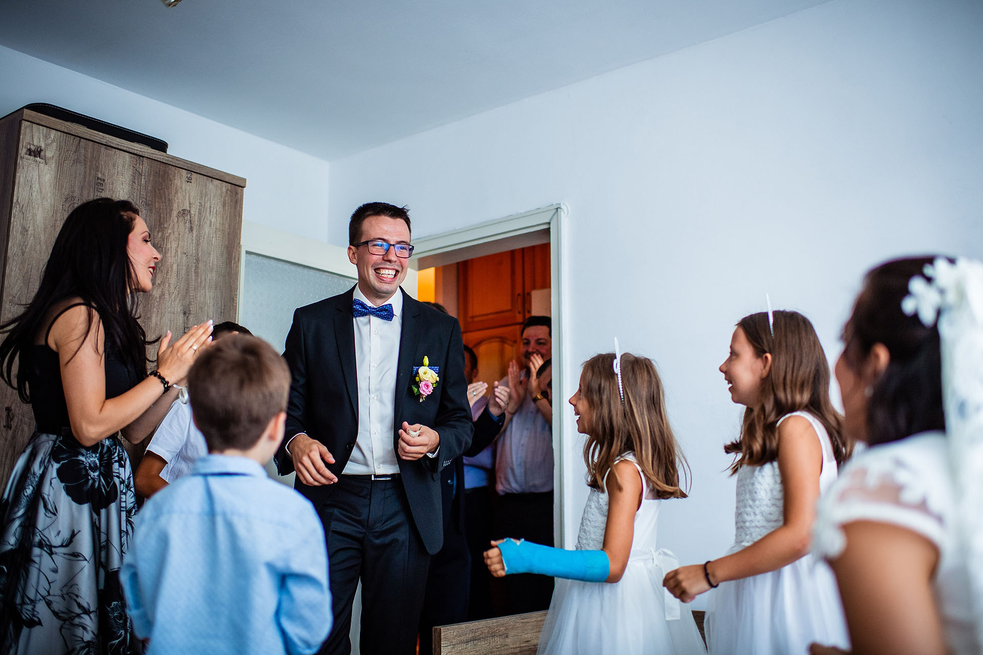 Bulgaria Elopement Pre-Ceremony Photography | the groom is allowed into the room and can't hide how excited he is to see his beautiful bride