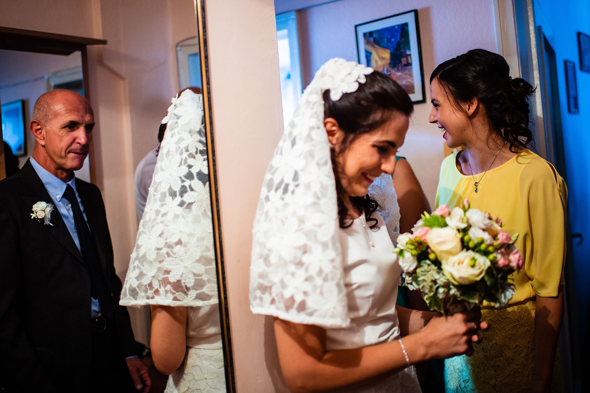 Bulgaria Elopement Bride and Father Picture | As the bride holds her bouquet and smiles, we can see her father in the reflection