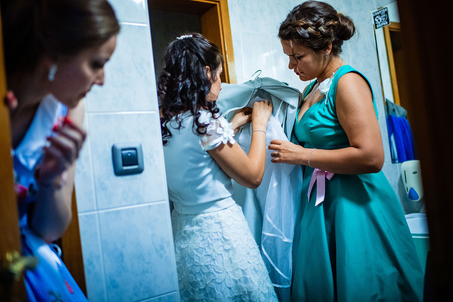 Bulgaria Elopement Post-Ceremony Bride Image | After the first ceremony, the bridesmaids help the bride change into her second wedding gown