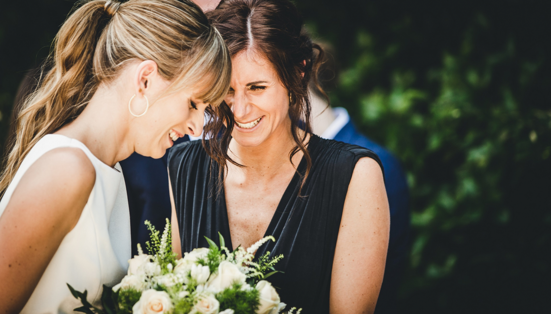 Italy Outdoor Elopement Bridal Image | After the ceremony, the bride's sister approaches her to congratulate her