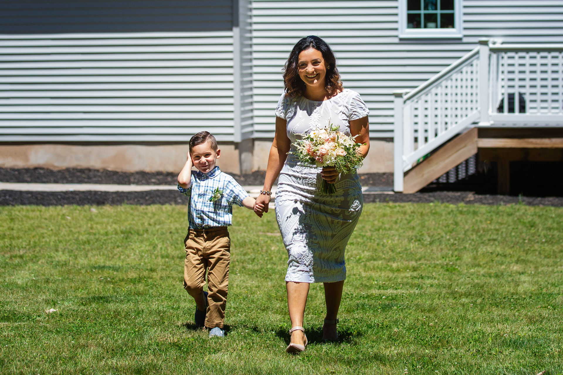 New Jersey Backyard Elopement Ceremony Photos   The bride and her young son walk down the aisle together