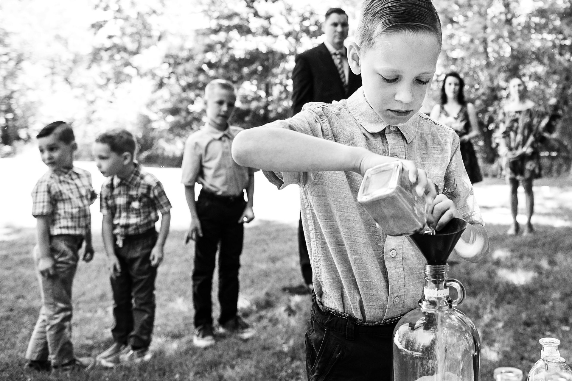 NJ Outdoor Elopement Ceremony Photographer   the boys couldn't help but be distracted by the sounds and sights of the backyard