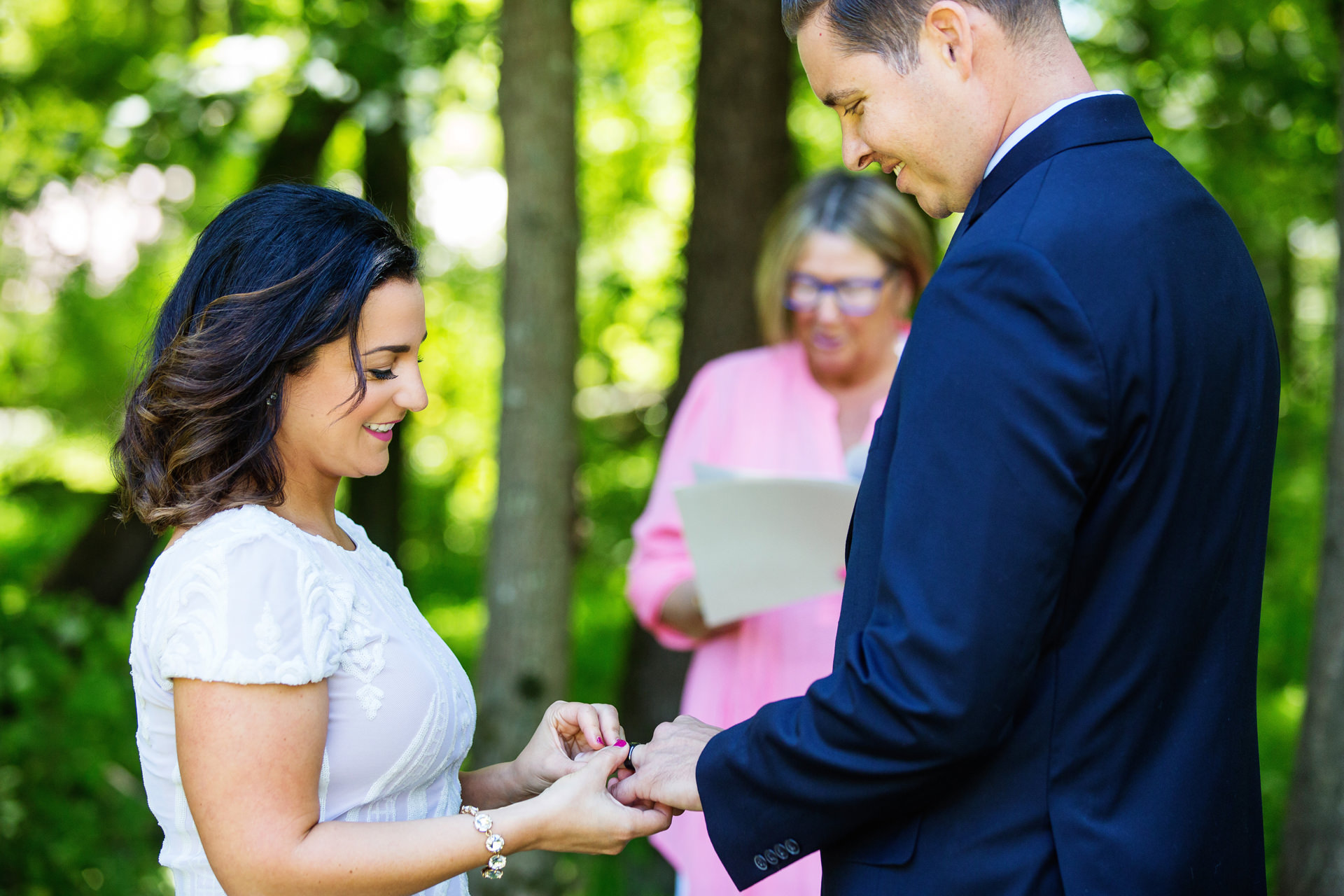 NJ Outdoor Elopement Photography   The couple smile as they exchange rings