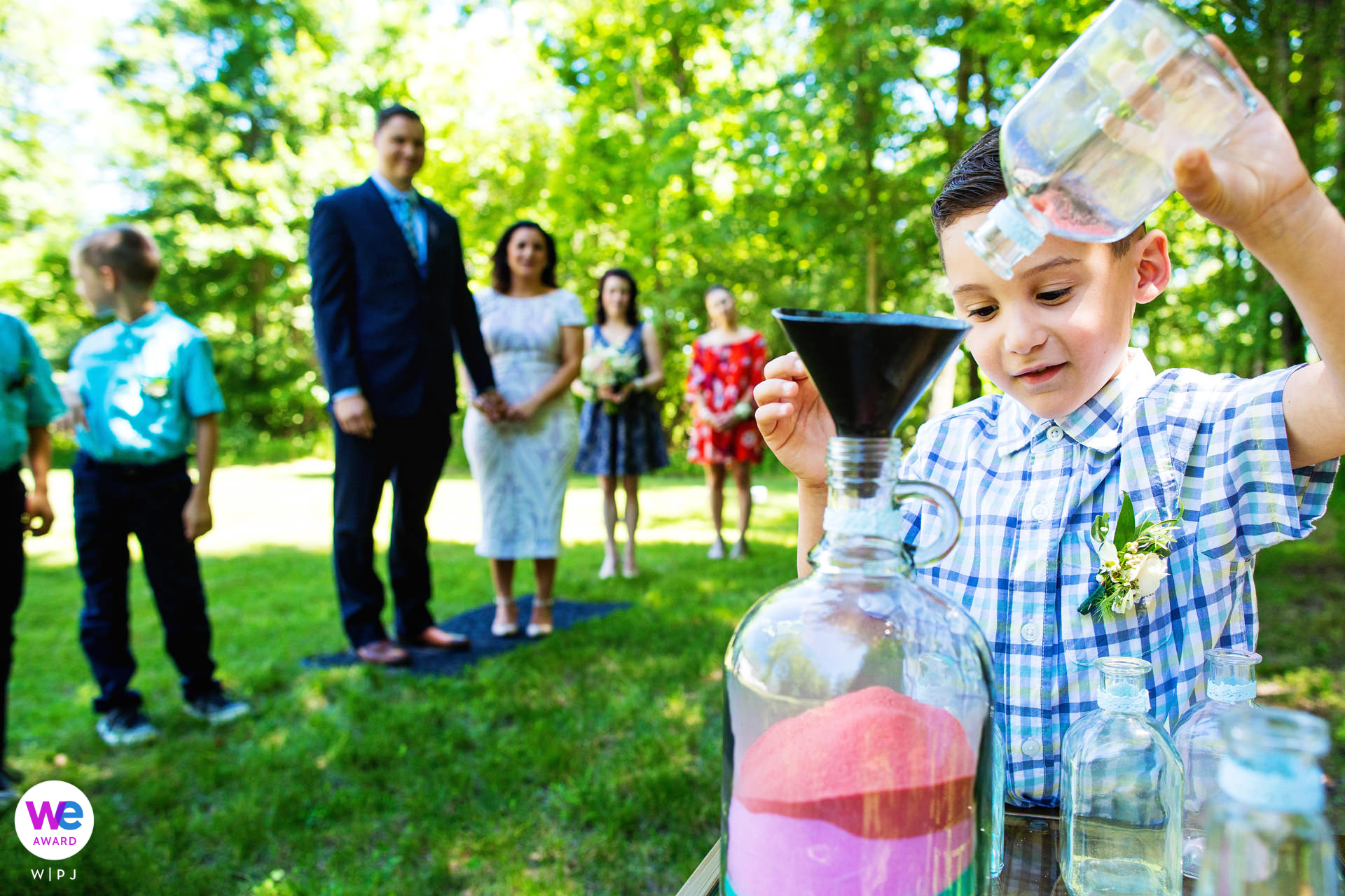 Hunterdon County, New Jersey Backyard Elopement Images   The boys enjoy themselves as they pour colored sand into a glass jar