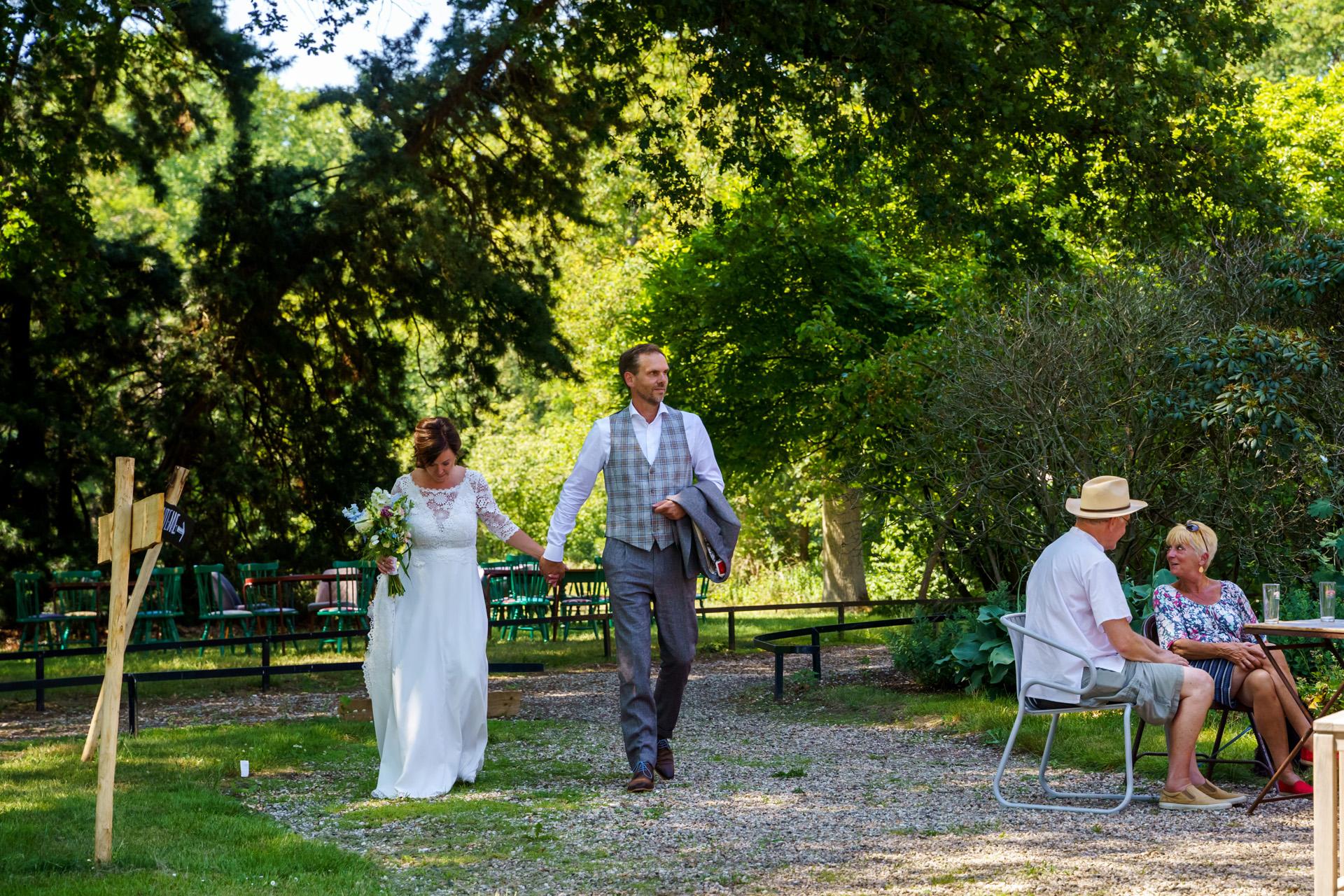 Deventer Outdoor Elopement Ceremony Image | The couple arrives hand-in-hand