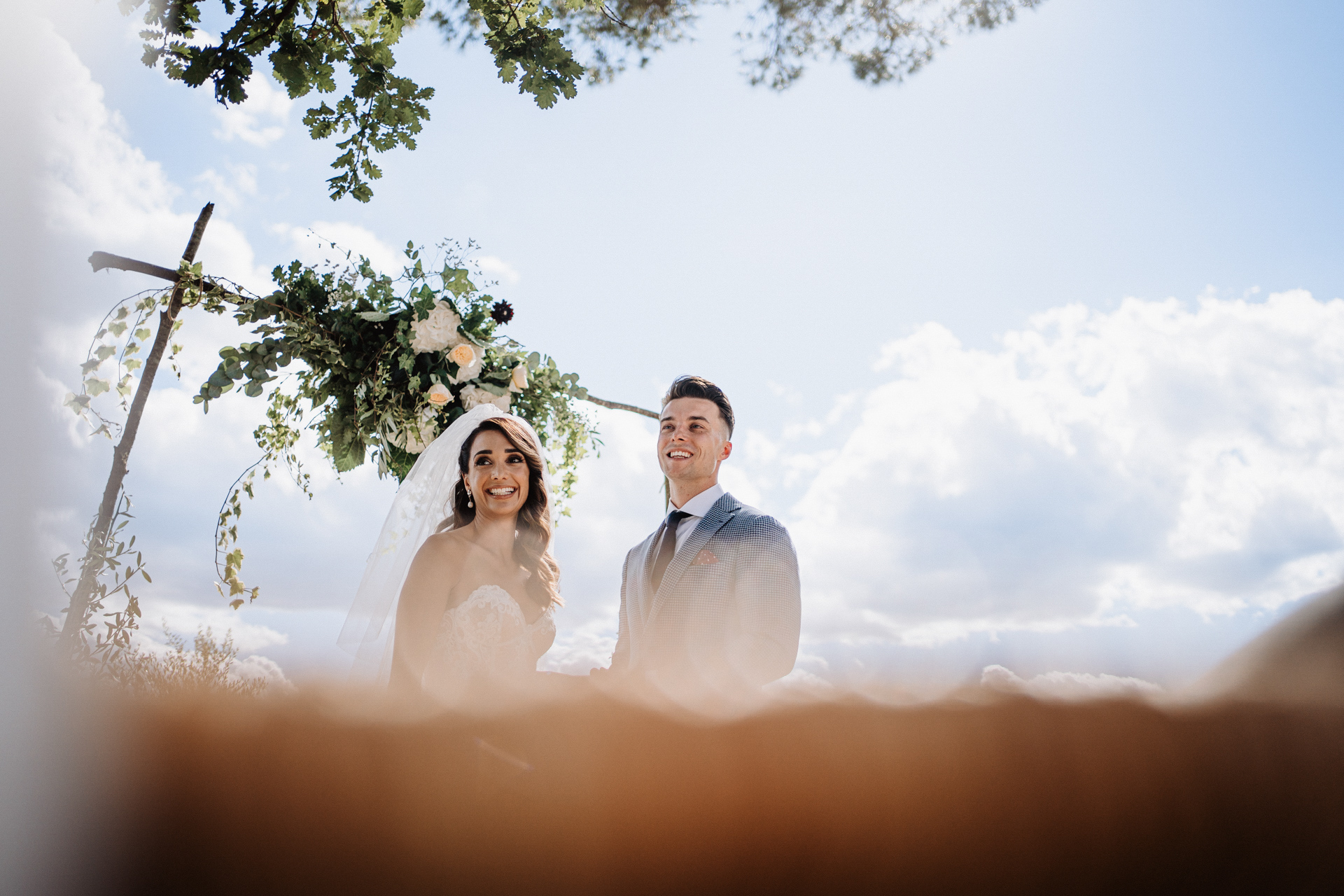 Fattoria di Corsignano Outdoor Elopement Ceremony Image | The couple caters to the guests