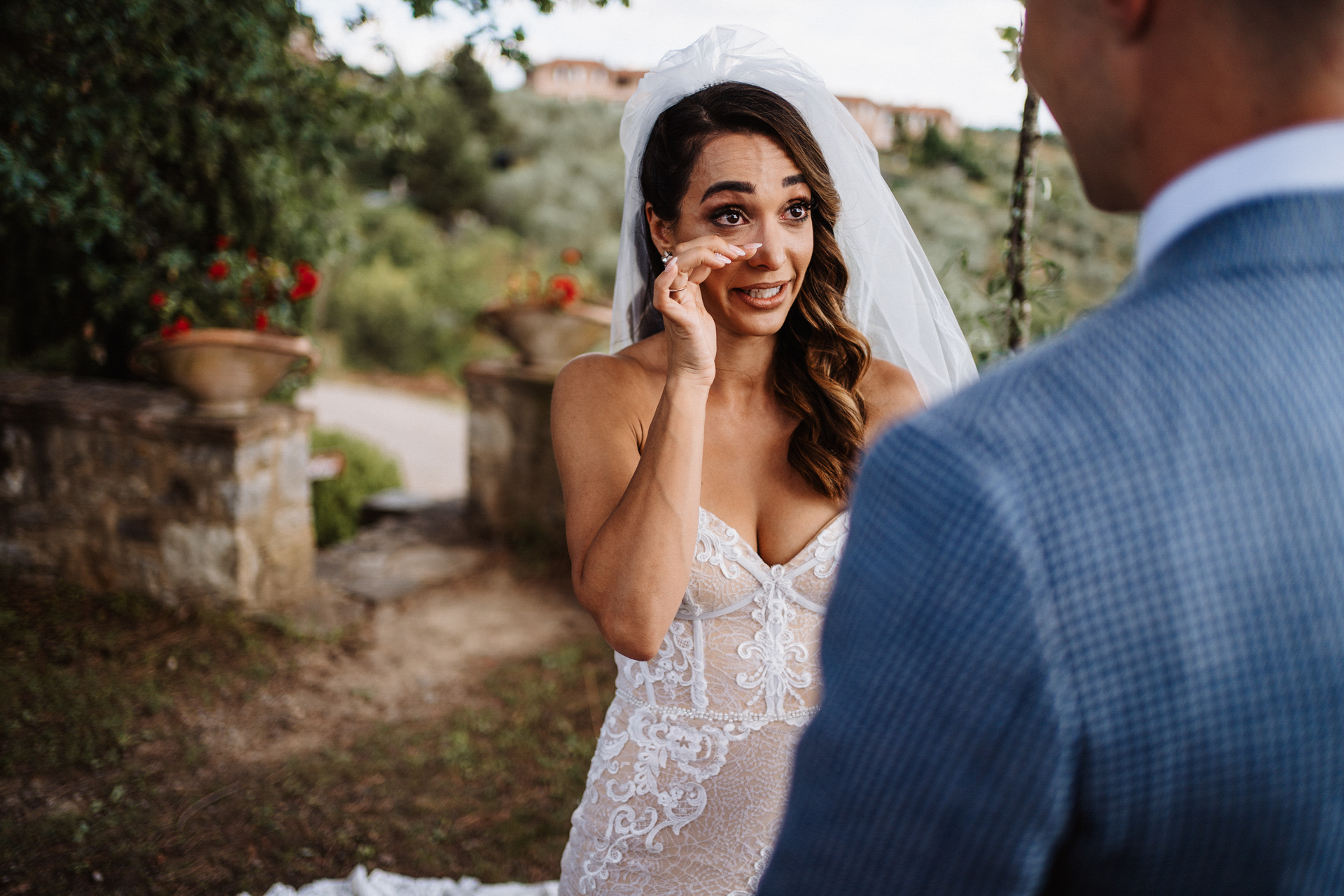 Outdoor Italy Elopement Ceremony Photography | The bride cries at the beautiful words of the groom