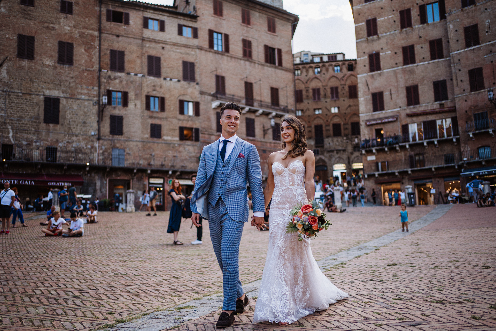 Piazza del Campo, Siena, Tuscany Elopement Portrait Session | After the ceremony, the couple heads from the countryside to the historic center of Siena