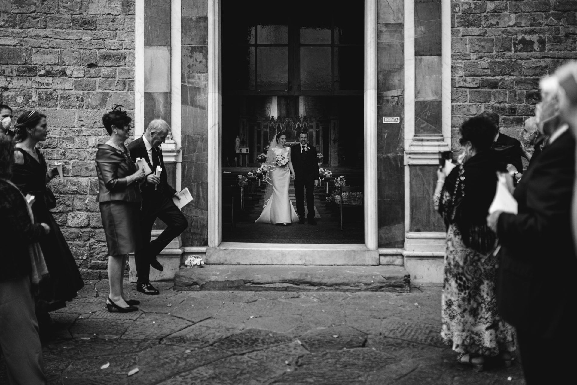 Tuscany Elopement Image | The bride and groom prepare to exit the ceremon