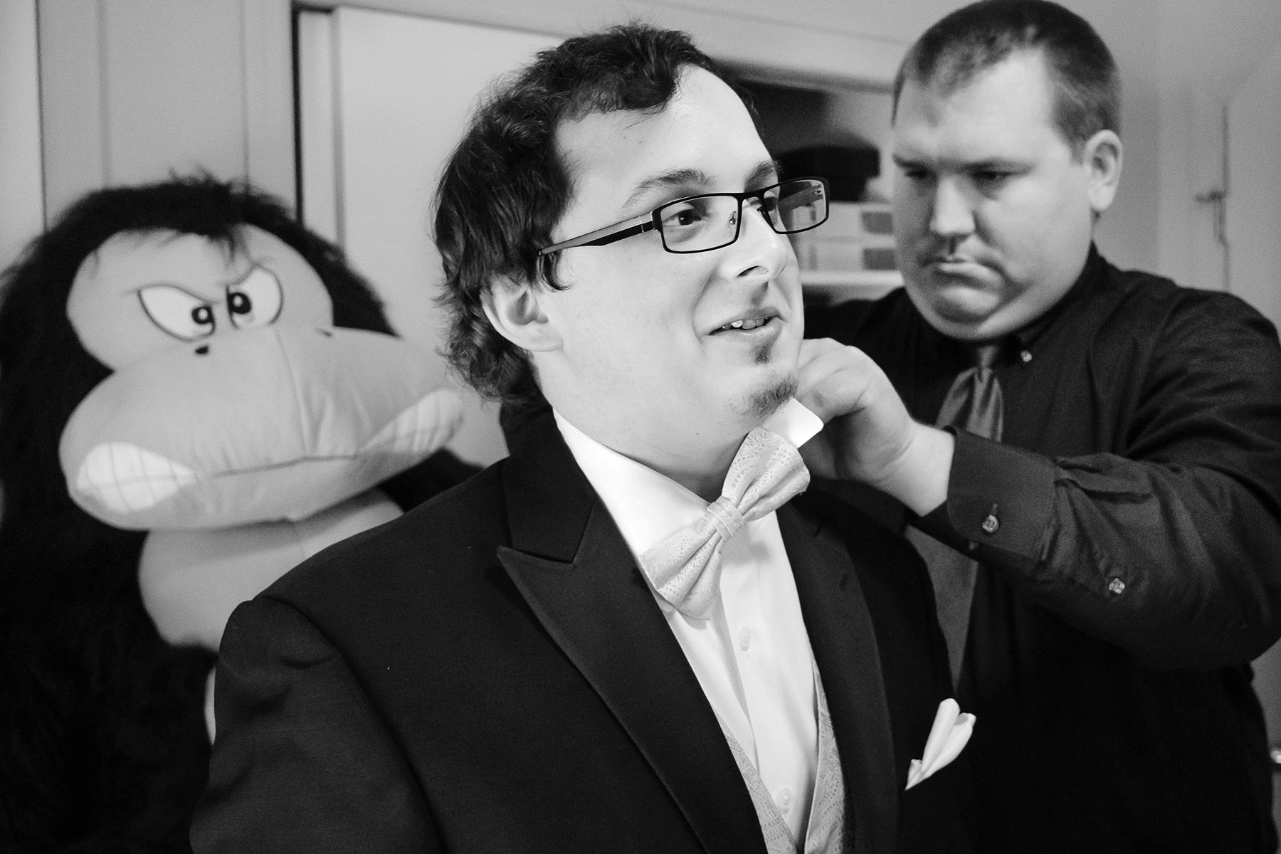 Tucker, Georgia Photographer - Beautiful Backyard Weddings | The best man adjusts his bow tie