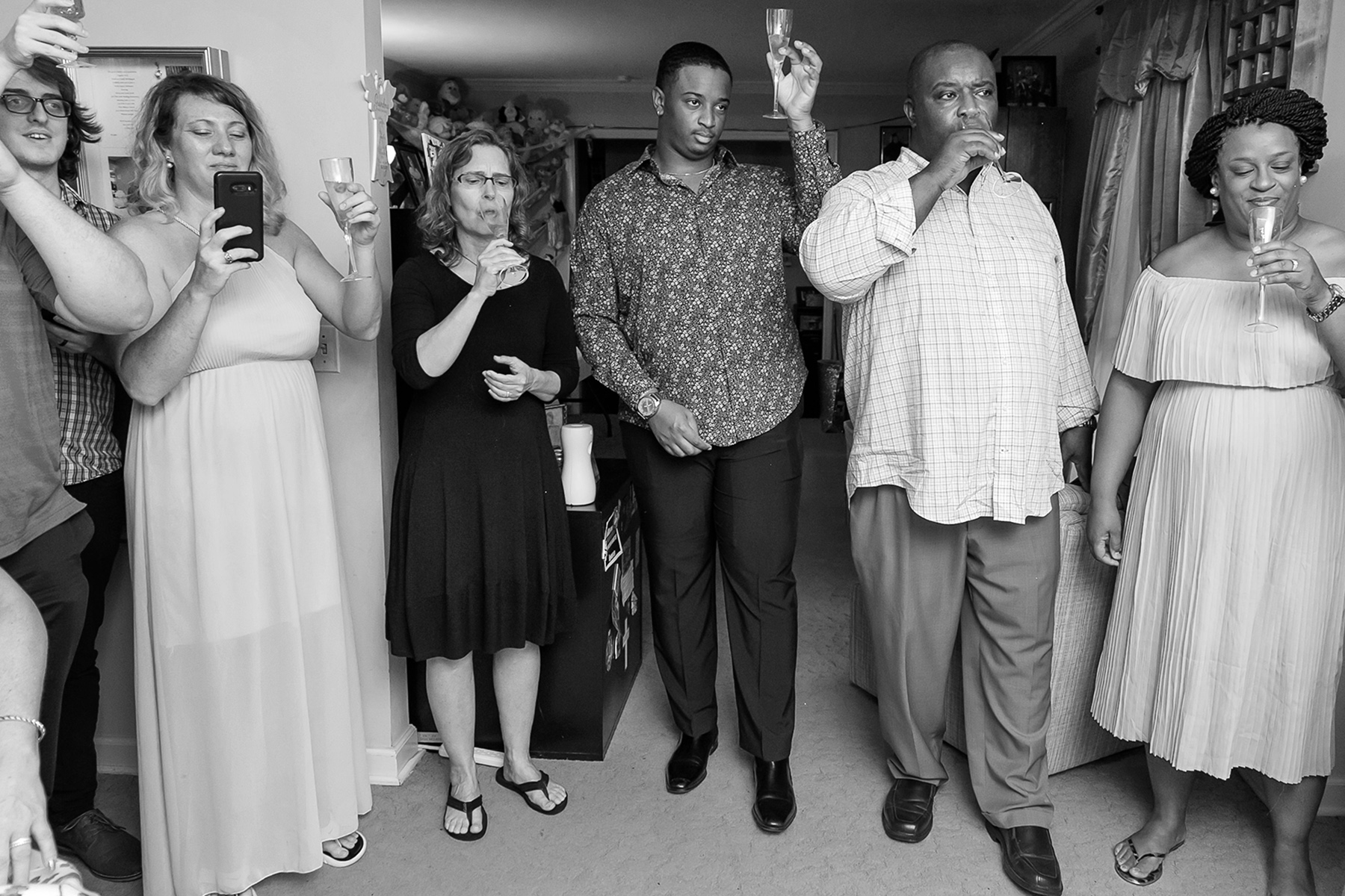 At-Home, Backyard Wedding Photography | Friends and family raise their glasses