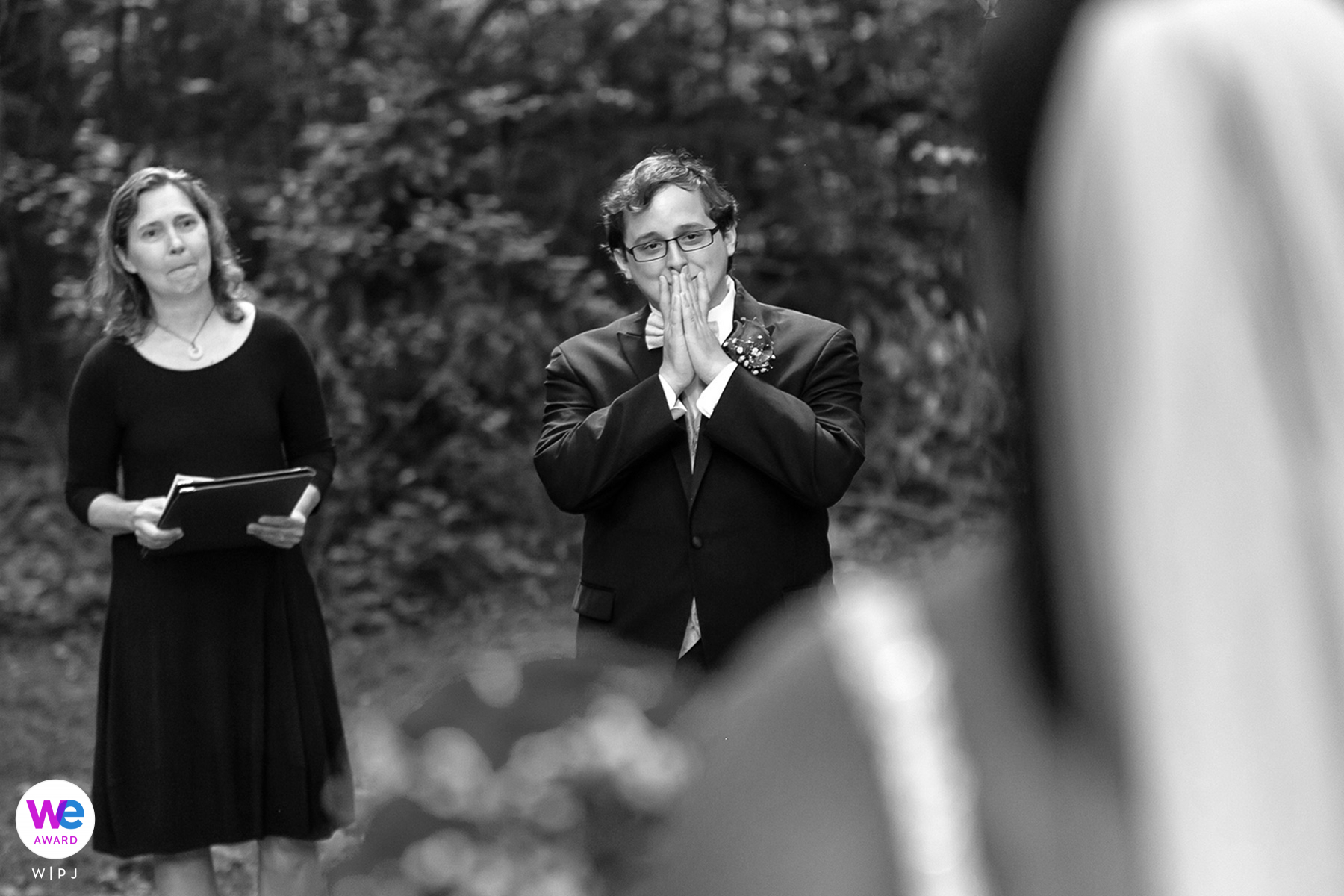 Intimate Backyard Wedding Photography | The groom sees the bride for the first time in her wedding dress