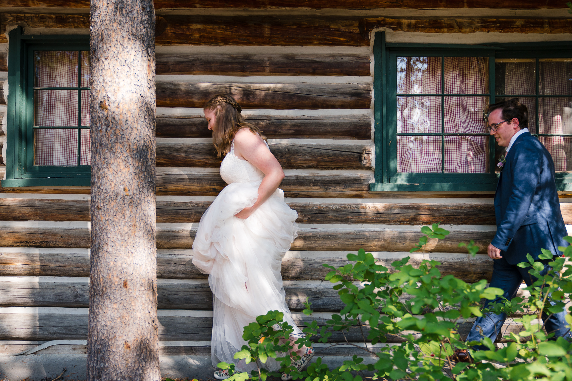 Grand Teton National Park Wyoming Elopement Photos | The bride and groom heading out of their cabin i