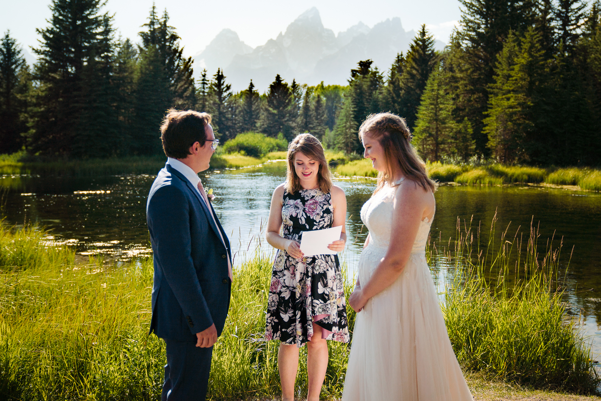 Schwabachers Landing in Grand Teton National Park Wyoming Elopement Ceremony Photo | The bride and groom's ceremony taking place outdoors in the sunshine