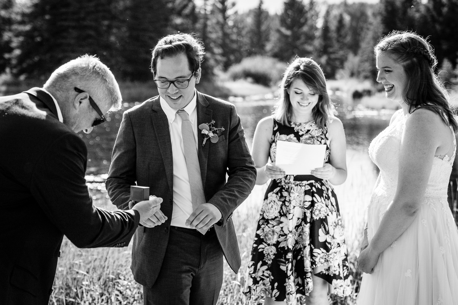 Schwabachers Landing, Wyoming Outdoor Elopement Ceremony Image | Father of the bride doing his duties with honor as he brings the rings