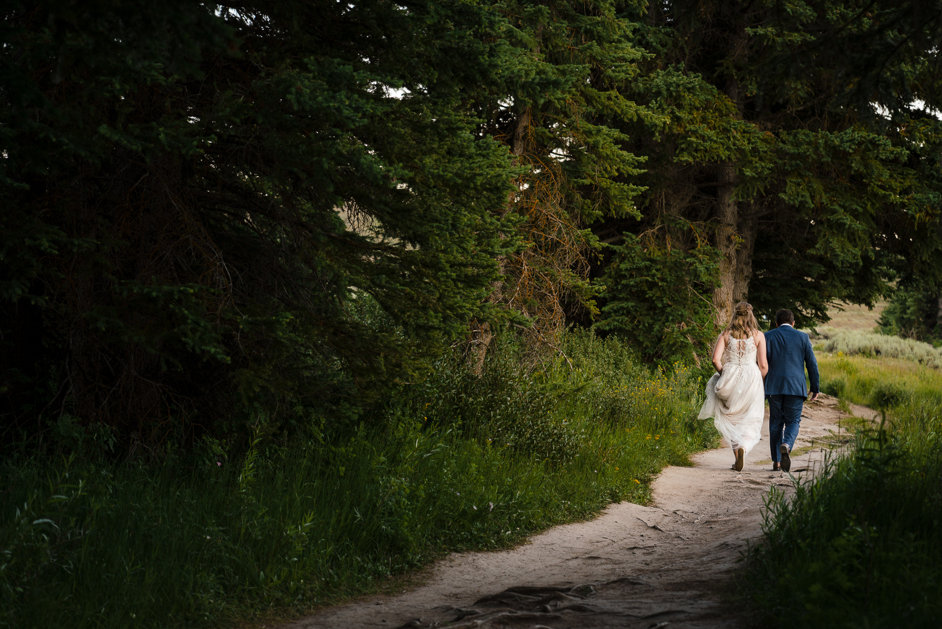 Wyoming Elopement Couple Pictures | the bride and groom head to their car to take off to the next location