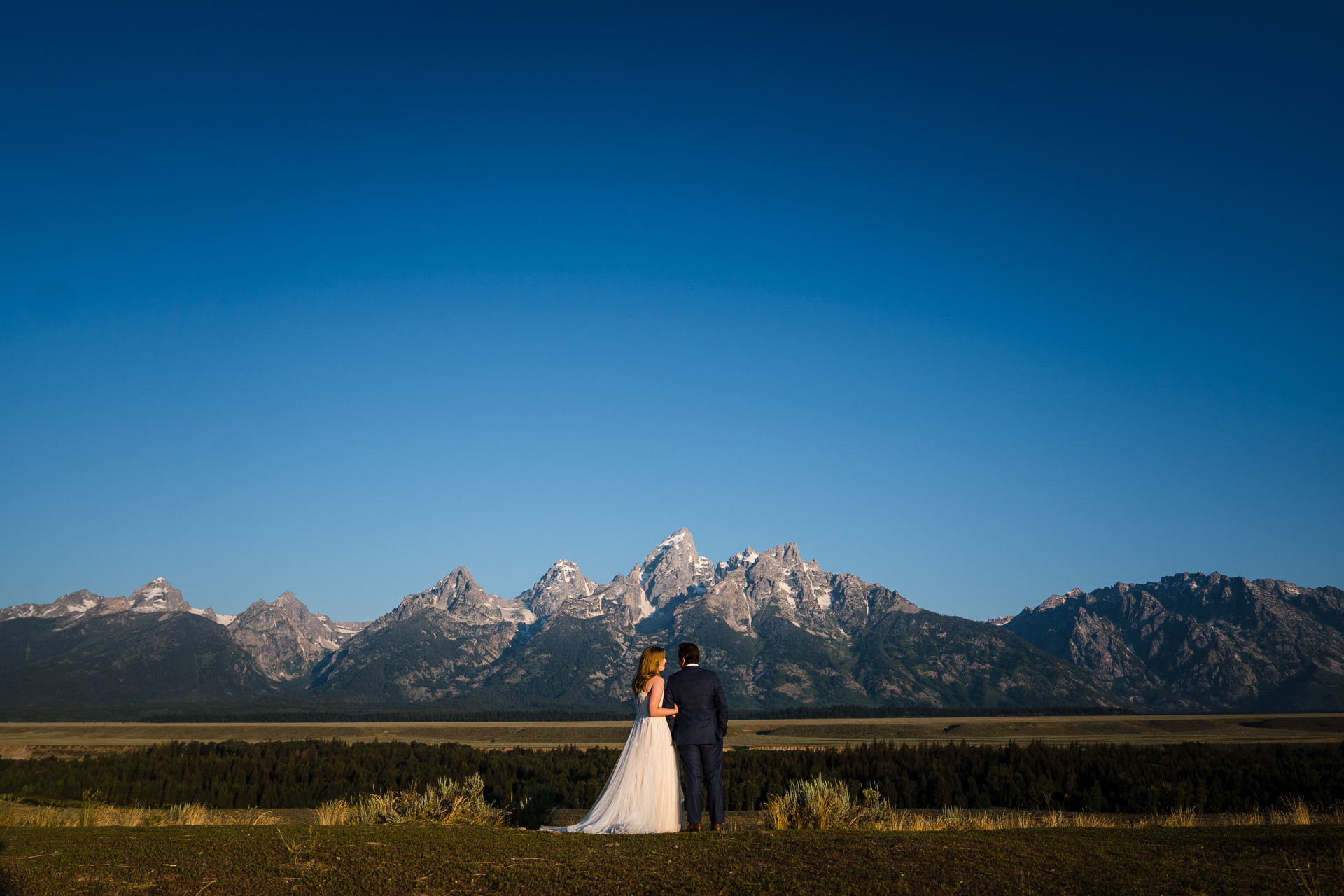 Grand Teton National Park Elopement Photographer | Bride and groom stopping for quick a portrait at an overlook