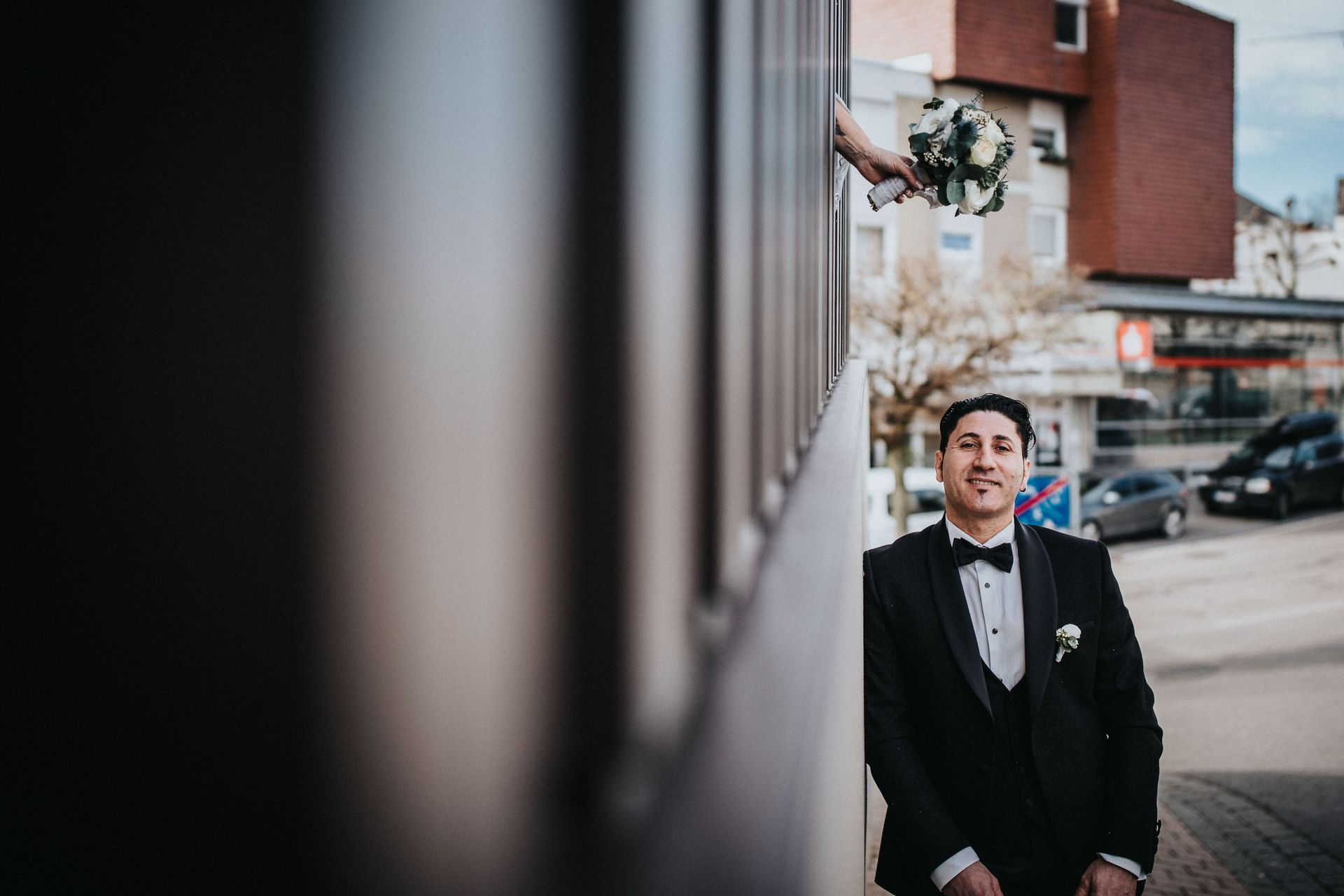 Hotel Restaurant Elopement Venue Images - Schwanen Köngen | The groom poses for a portrait in the city's streets